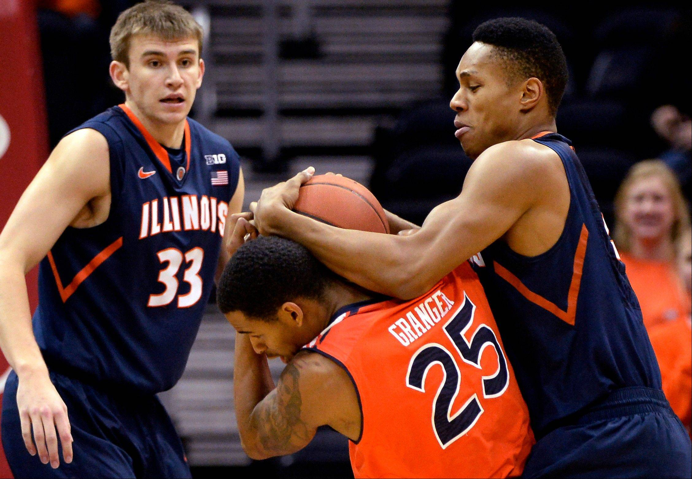 Auburn's Jordan Granger (25) and Illinois' Joseph Bertrand (2) battle for the rebound as Illinois' Jon Ekey (33) looks on in the first half of an NCAA college basketball game on Sunday, Dec. 8, 2013, in Atlanta.