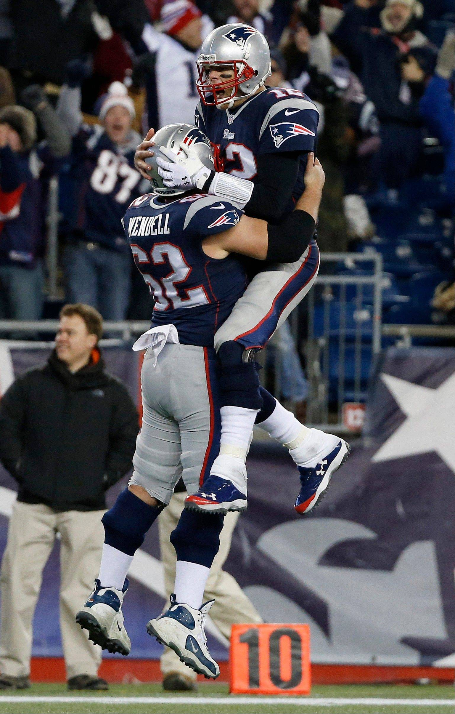 New England Patriots quarterback Tom Brady, right, celebrates his go-ahead touchdown pass with center Ryan Wendell (62) in the fourth quarter of an NFL football game against the Cleveland Browns Sunday, Dec. 8, 2013, in Foxborough, Mass. The Patriots came from behind to win 27-26.