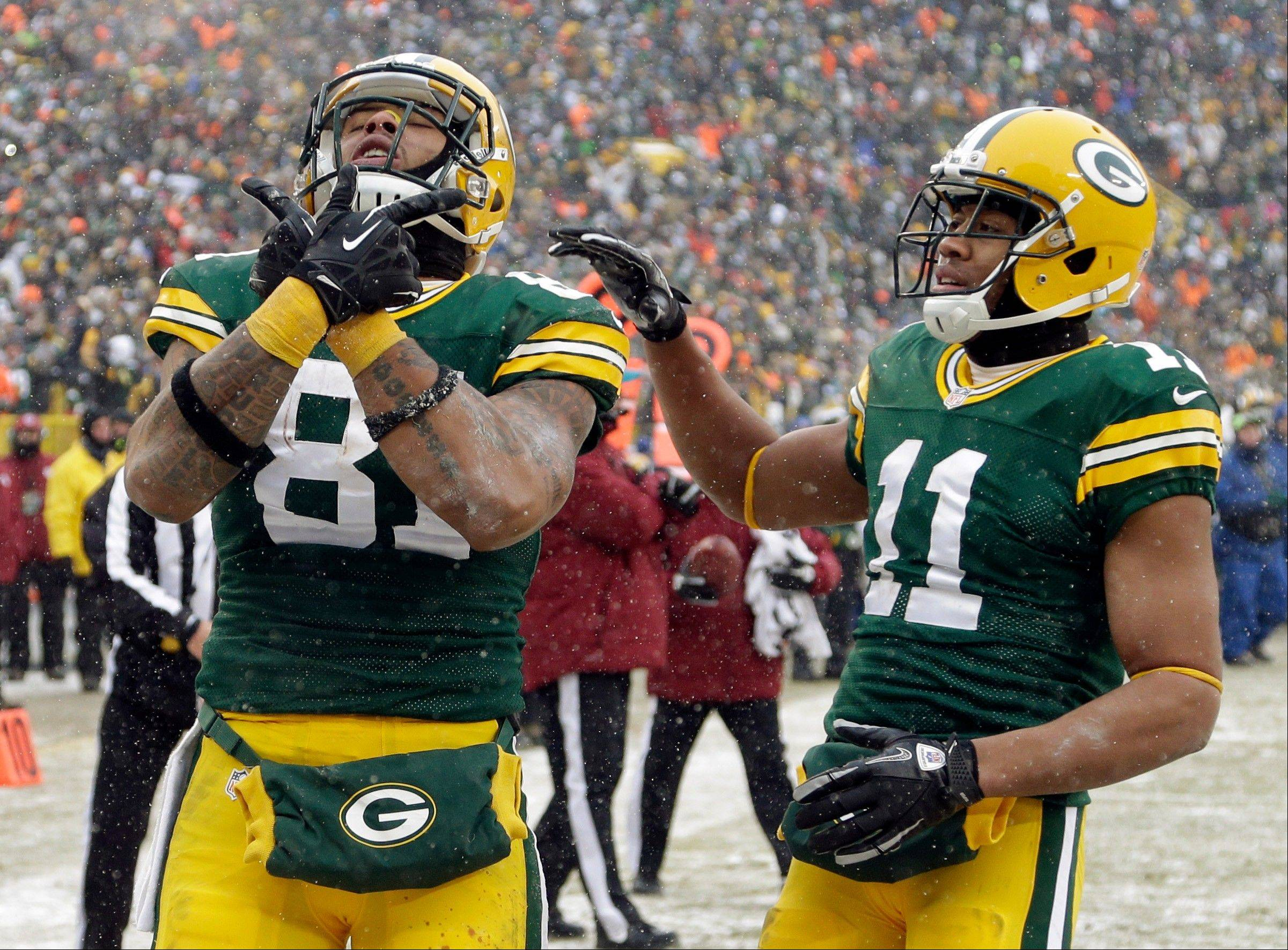 Green Bay Packers� Andrew Quarless (81) is congratulated by Jarrett Boykin (11) after catching a touchdown pass during the second half of an NFL football game against the Atlanta Falcons Sunday, Dec. 8, 2013, in Green Bay, Wis.