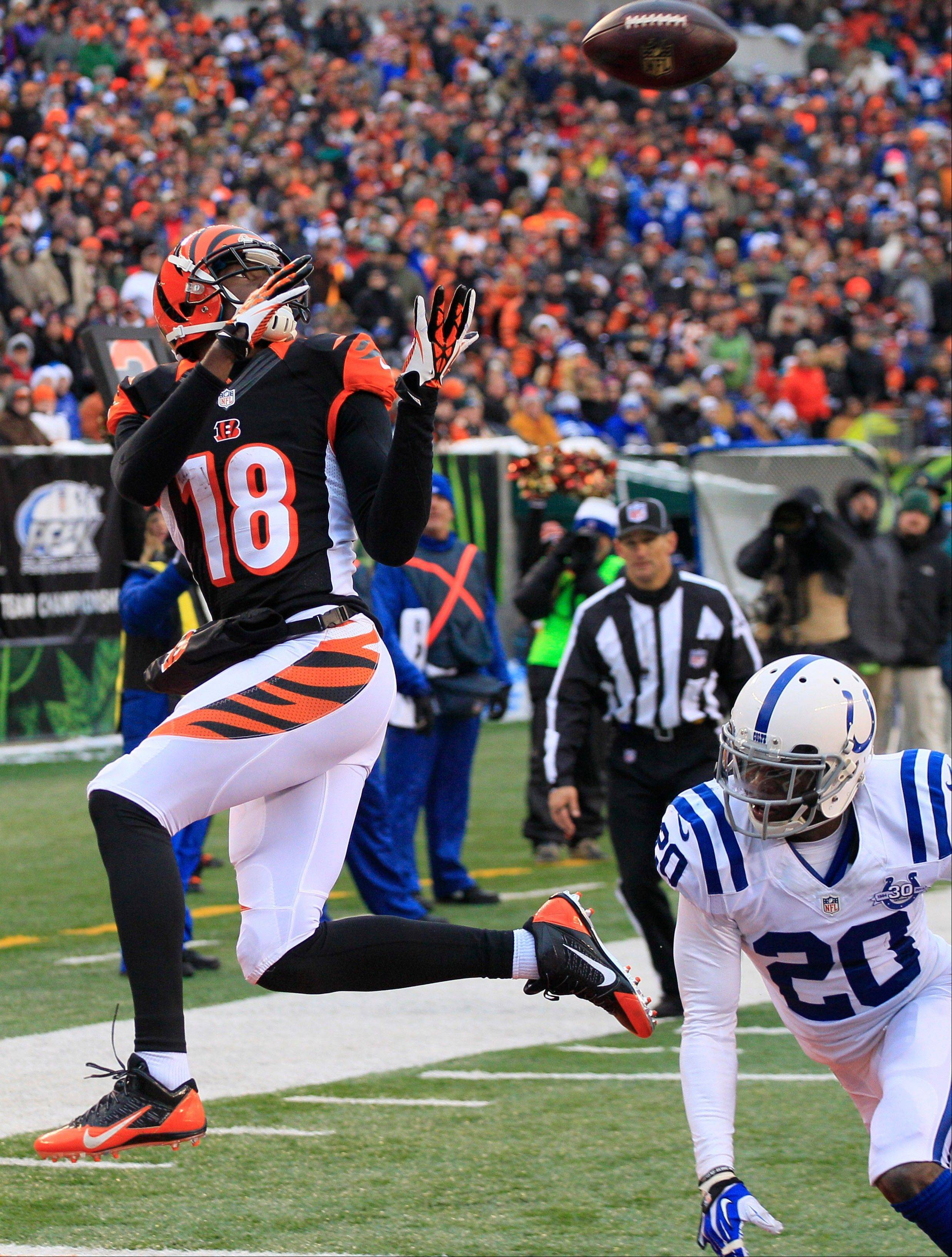 Cincinnati Bengals wide receiver A.J. Green (18) catches a 9-yard touchdown pass against Indianapolis Colts free safety Darius Butler (20) in the second half of an NFL football game, Sunday, Dec. 8, 2013, in Cincinnati.