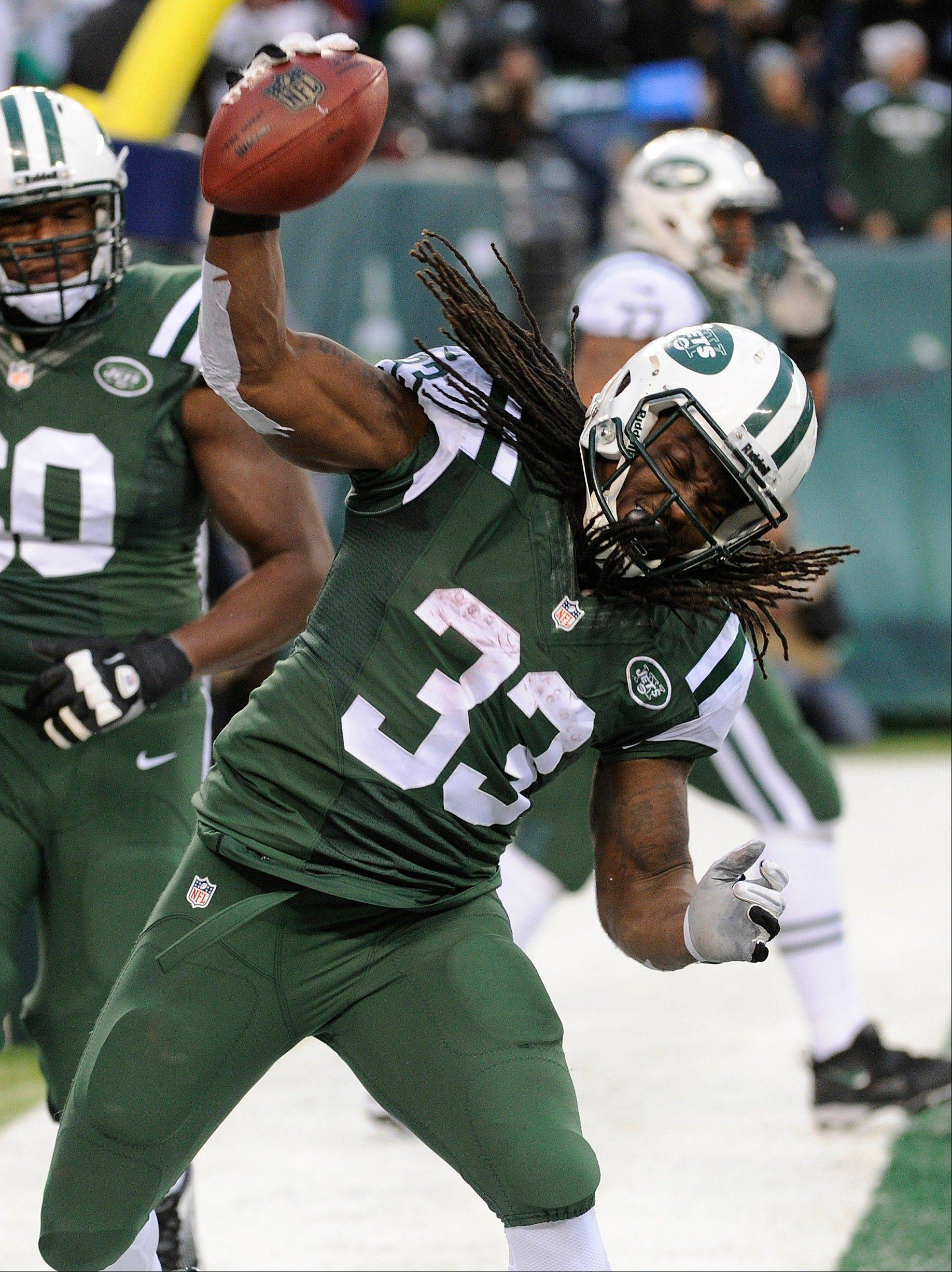New York Jets running back Chris Ivory (33) spikes the ball after scoring on a touchdown run against the Oakland Raiders during the second half of an NFL football game, Sunday, Dec. 8, 2013, in East Rutherford, N.J.