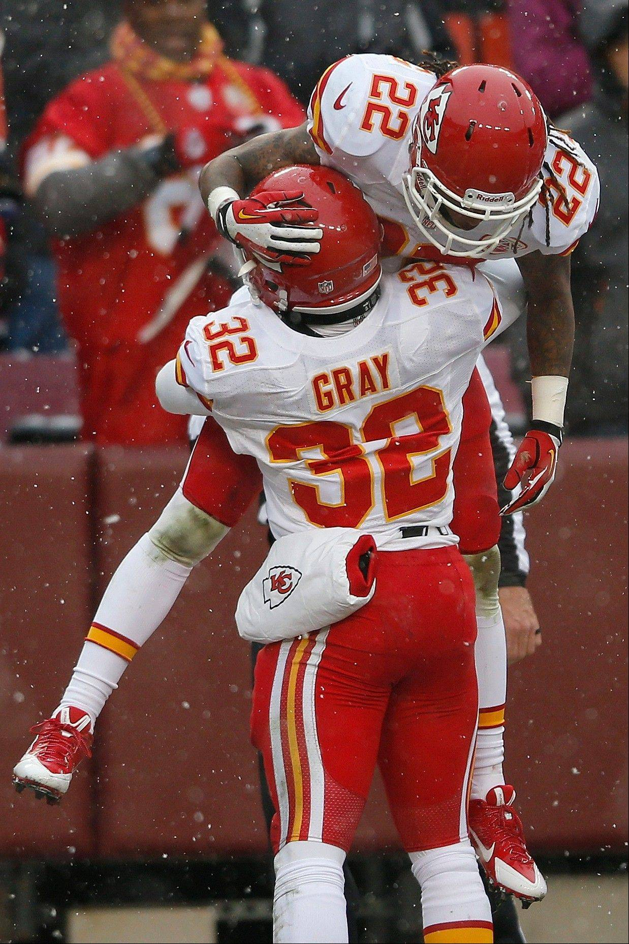 Kansas City Chiefs running back Cyrus Gray picks up wide receiver Dexter McCluster after McCluster returned a punt for a touchdown during the first half of an NFL football game against Washington in Landover, Md., Sunday, Dec. 8, 2013.