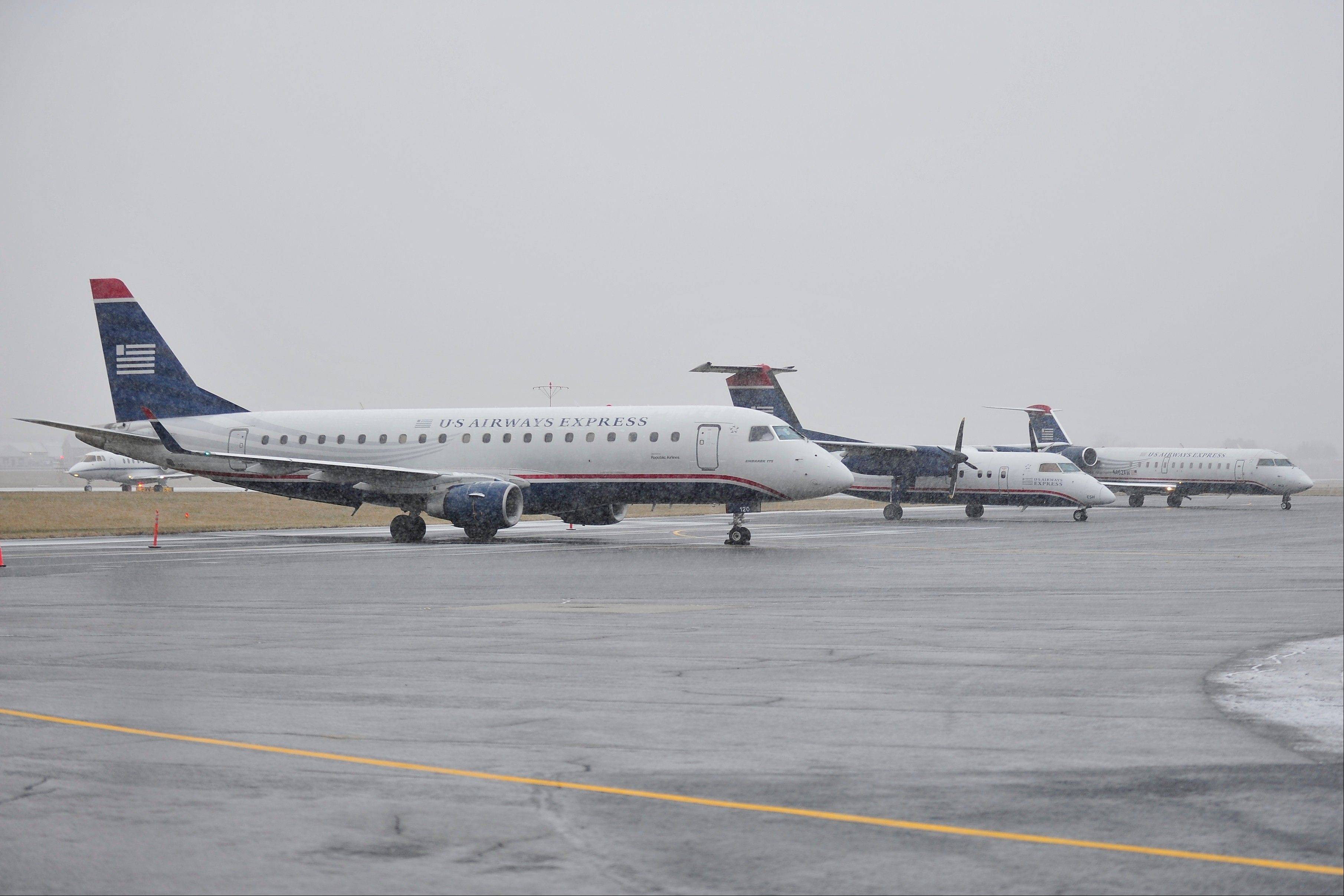 Aircraft diverted from the Philadelphia International Airport lineup on the ramp at Lehigh Valley International Airport Sunday in Allentown, Pa. Heavy snow and icing conditions forced the aircraft to divert from landing at Philadelphia.