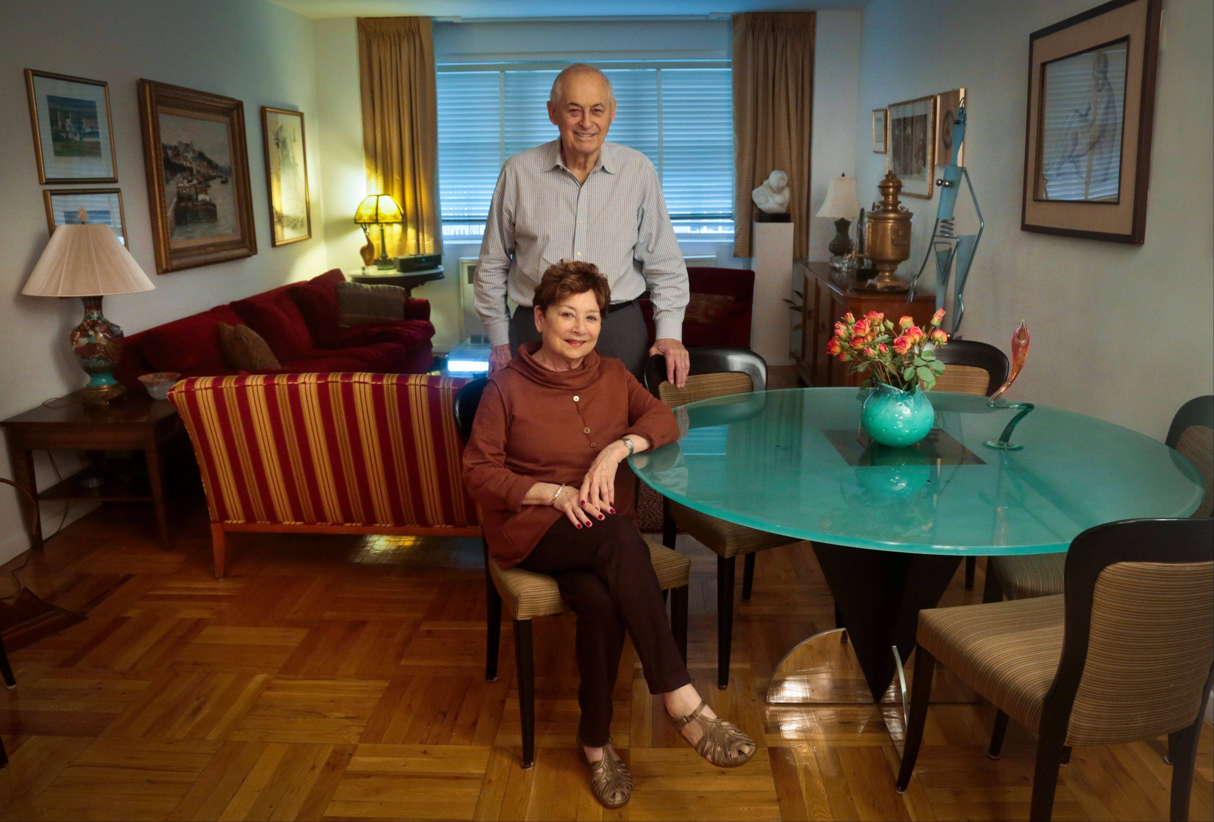 Victims of Bernie Madoff's massive Ponzi scheme, Morton Chalek, 91, standing, a WWII vet, and his friend Fran Reiss, 79, a retired educator, pose in the apartment they share. With the fifth anniversary of Madoff's fraud approaching, Chalek and Reiss are among a legion of former investors still struggling to move on after seeing their life savings go up in flames.