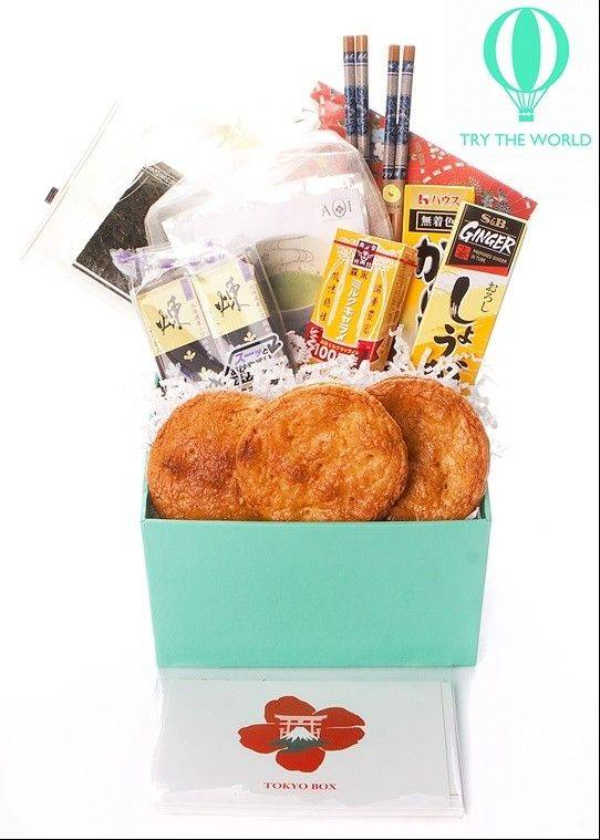 This handout product image provided by trytheworld.com shows the company's subscription offering. Trytheworld.com sends subscribers a box of hard-to-find items like jams, fine teas and films from a different city (Paris, Tokyo and Rio) every two months for a $45 fee for each box. (