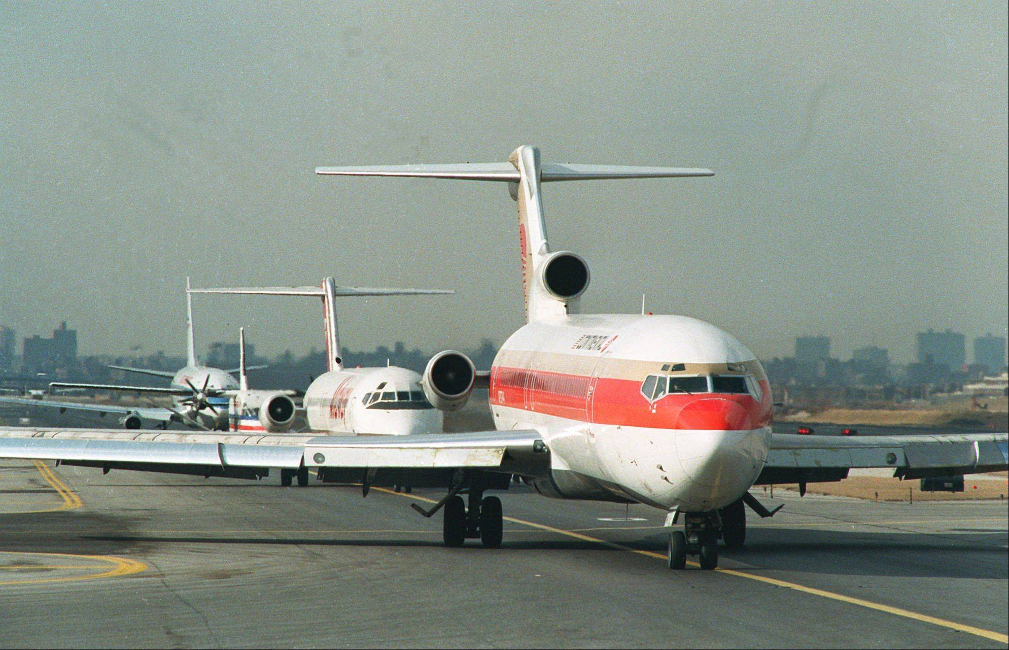 Associated Press File PhotoIn this February 1989 file photo, airplanes line up on the runway of New York's La Guardia Airport cued for takeoff. On Sunday, Feb. 17, 2013, New York Governor Andrew Cuomo said that LaGuardia Airport is set to receive $37.5 million in federal and state funds for five projects that will protect the runways and flood barrier berms breached by Supertsorm Sandy.