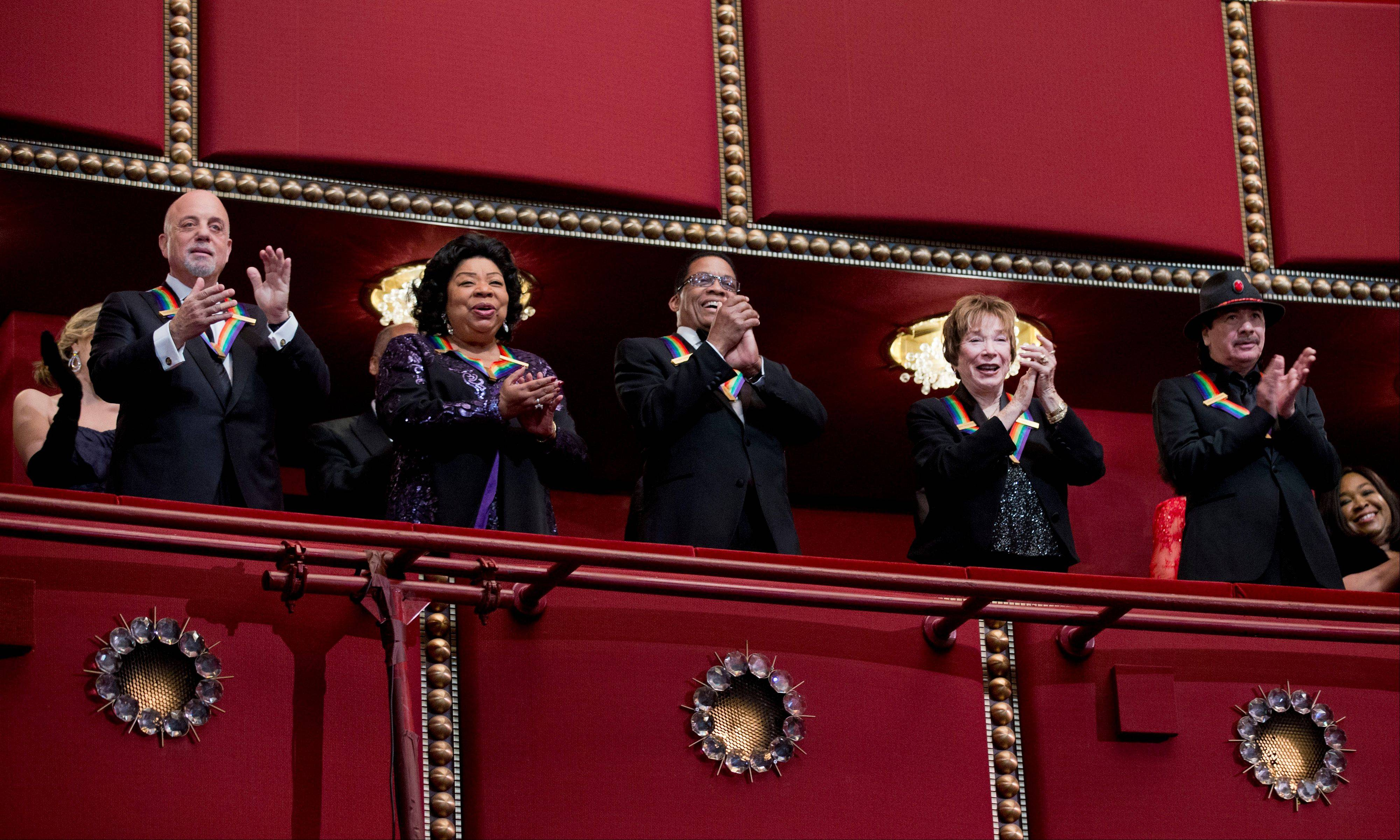 The recipients of the 2013 Kennedy Center Honors, from left, Billy Joel, Martina Arroyo, Herbie Hancock, Shirley MacLaine, and Carlos Santana, give their applause Sunday during the Kennedy Center Honors Gala at the Kennedy Center in Washington.