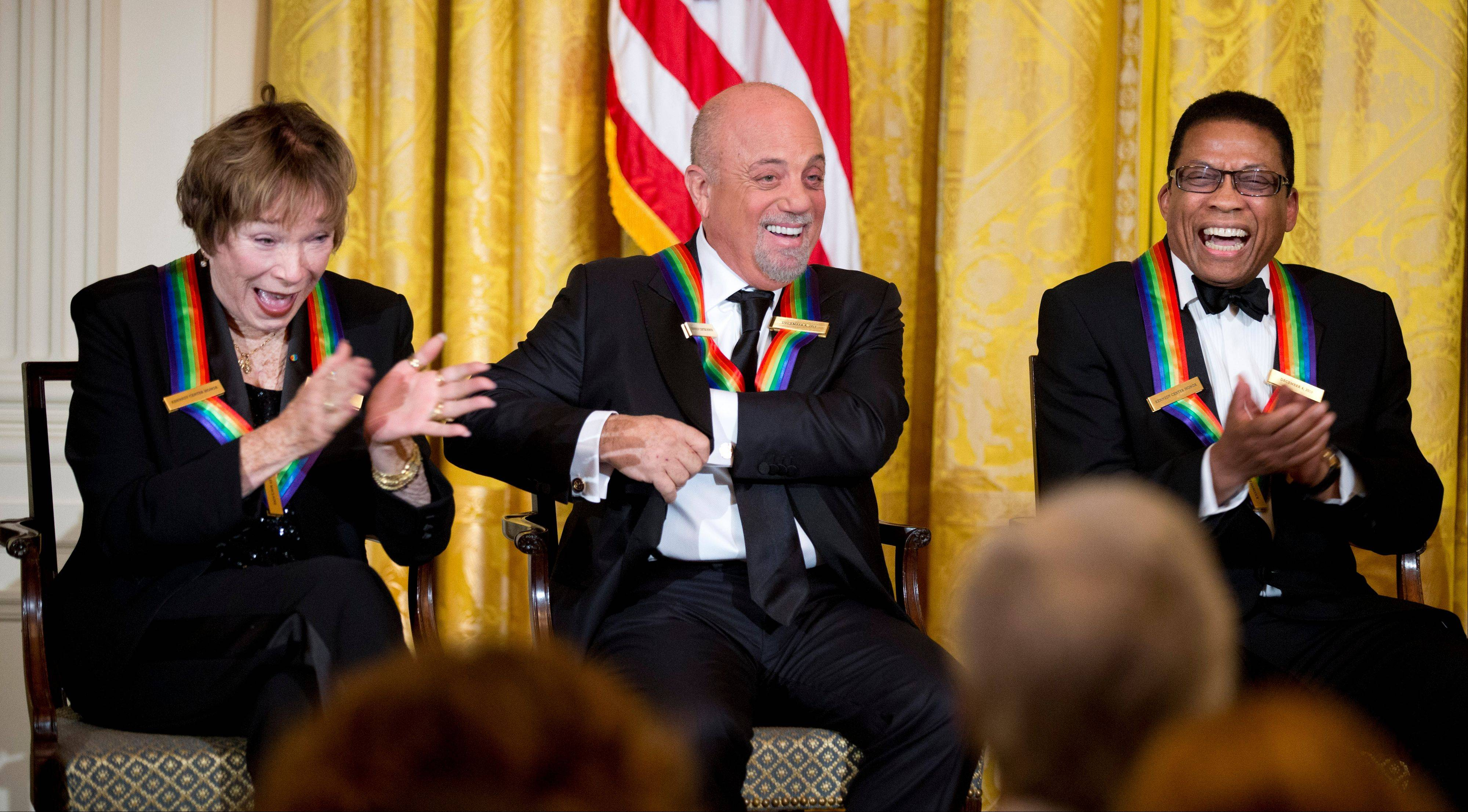 Recipients of the 2013 Kennedy Center Honors, from left; Shirley MacLaine, Billy Joel and Herbie Hancock, laugh during a reception Sunday honoring the 2013 Kennedy Center Honors recipients in the East Room of the White House in Washington.