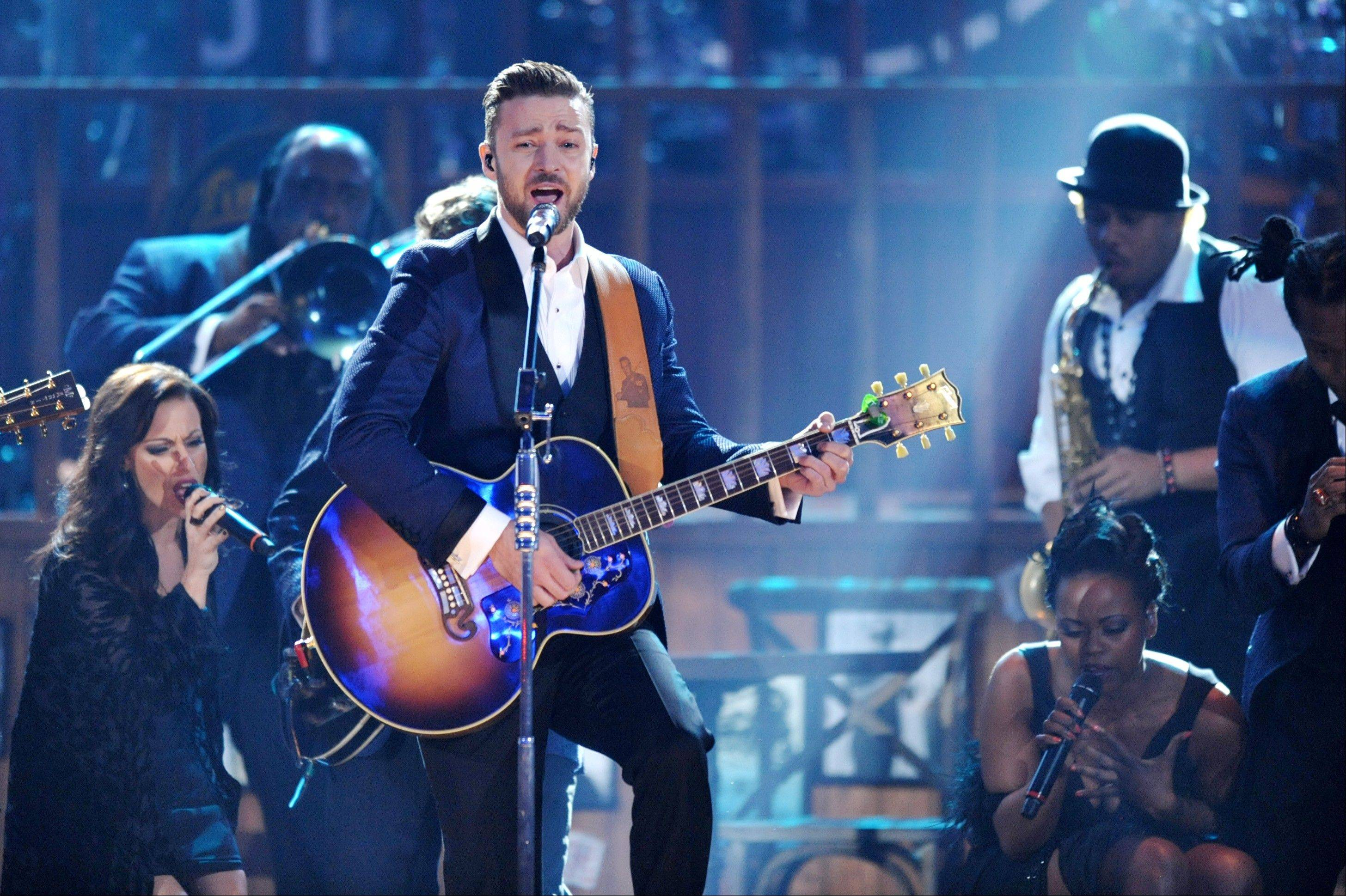 "Justin Timberlake, center, performs on stage at the American Music Awards at the Nokia Theatre L.A. Live in Los Angeles. Though Timberlake's ""The 20/20 Experience"" is a best-seller, he was largely shut out of the top Grammy categories."