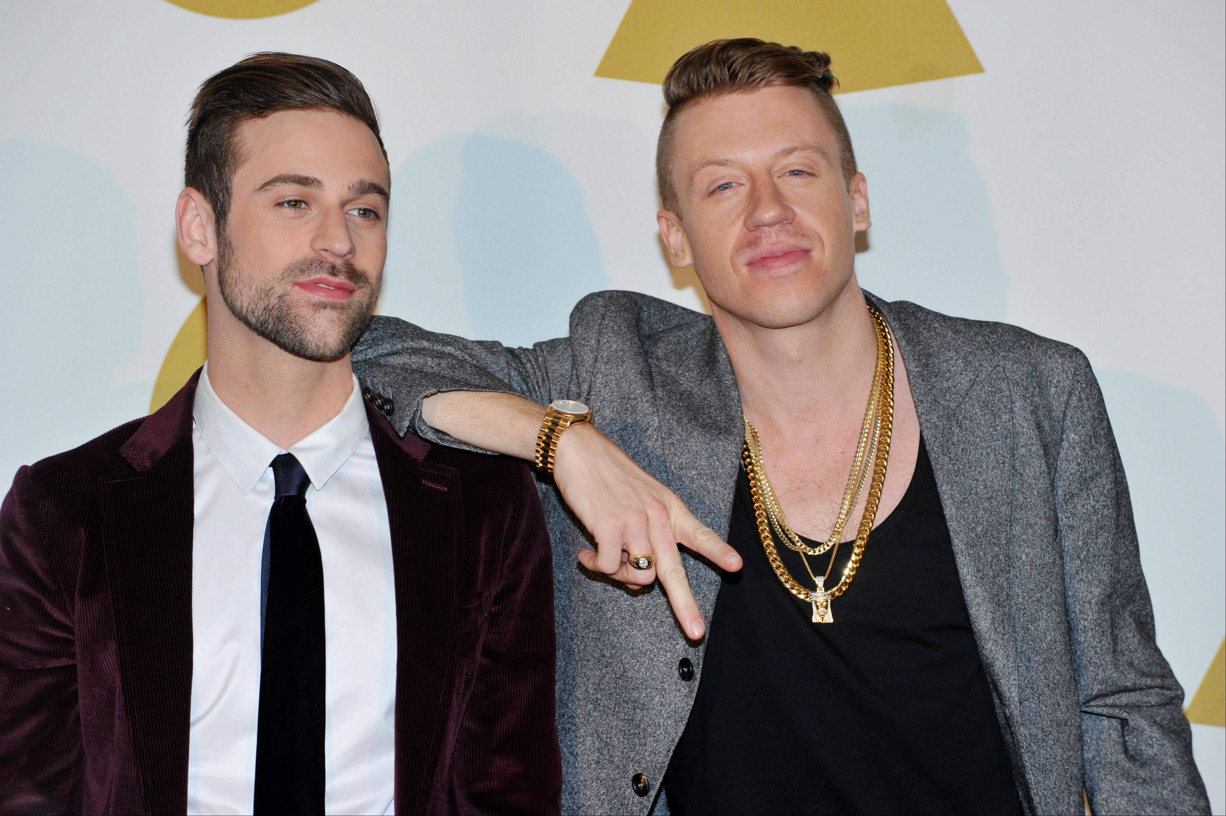 Ryan Lewis, left, and Macklemore pose backstage at the Grammy Nominations Concert Live! on Friday at the Nokia Theatre L.A. Live in Los Angeles.