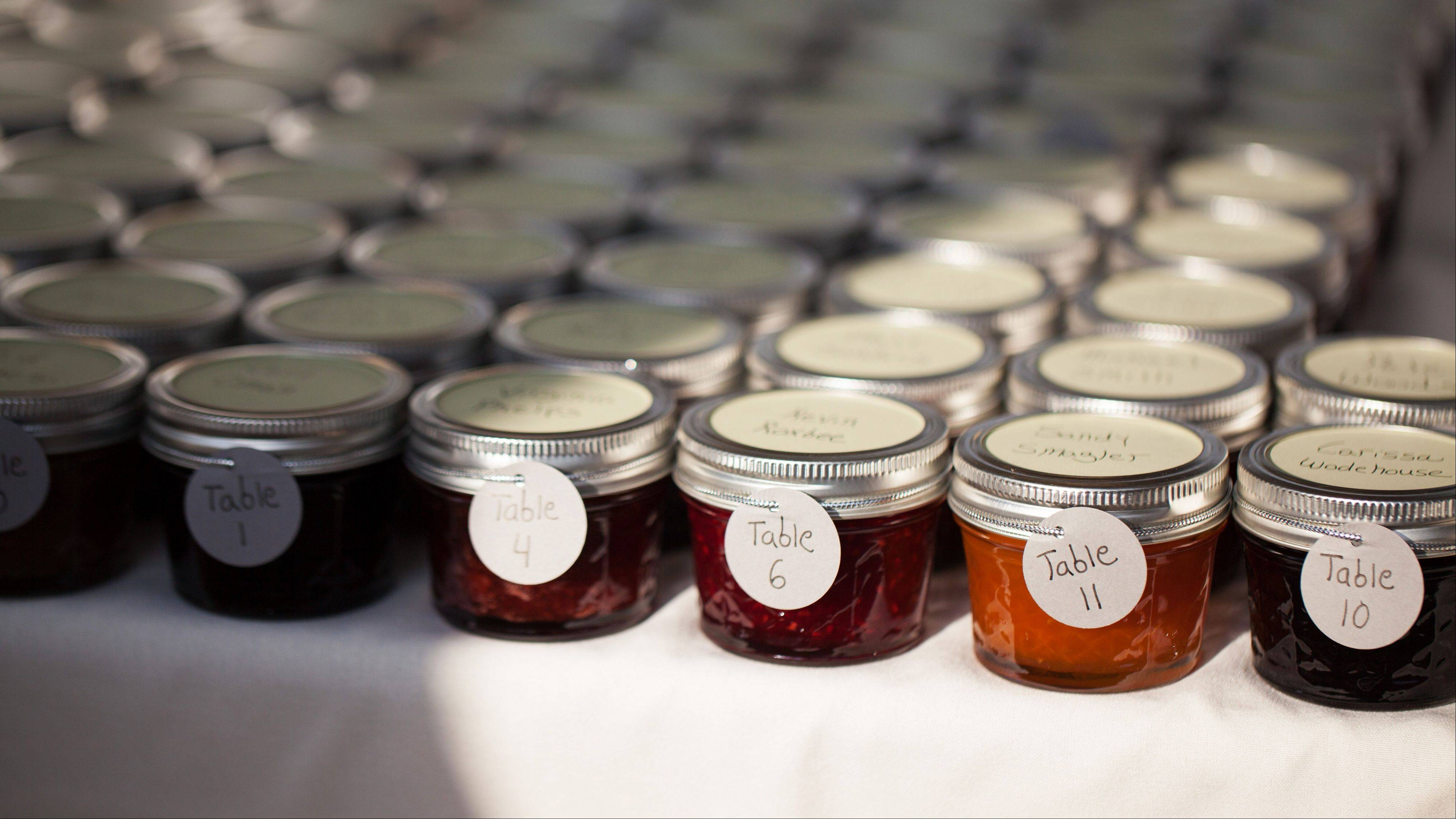 Homemade jam favors made by Jillian Simms for the guests at her wedding to Jason Simms. The favor, that little thank-you-for-coming gift, has risen to new heights with the bride and groom giving guests a wide range of favors that are meaningful to them.