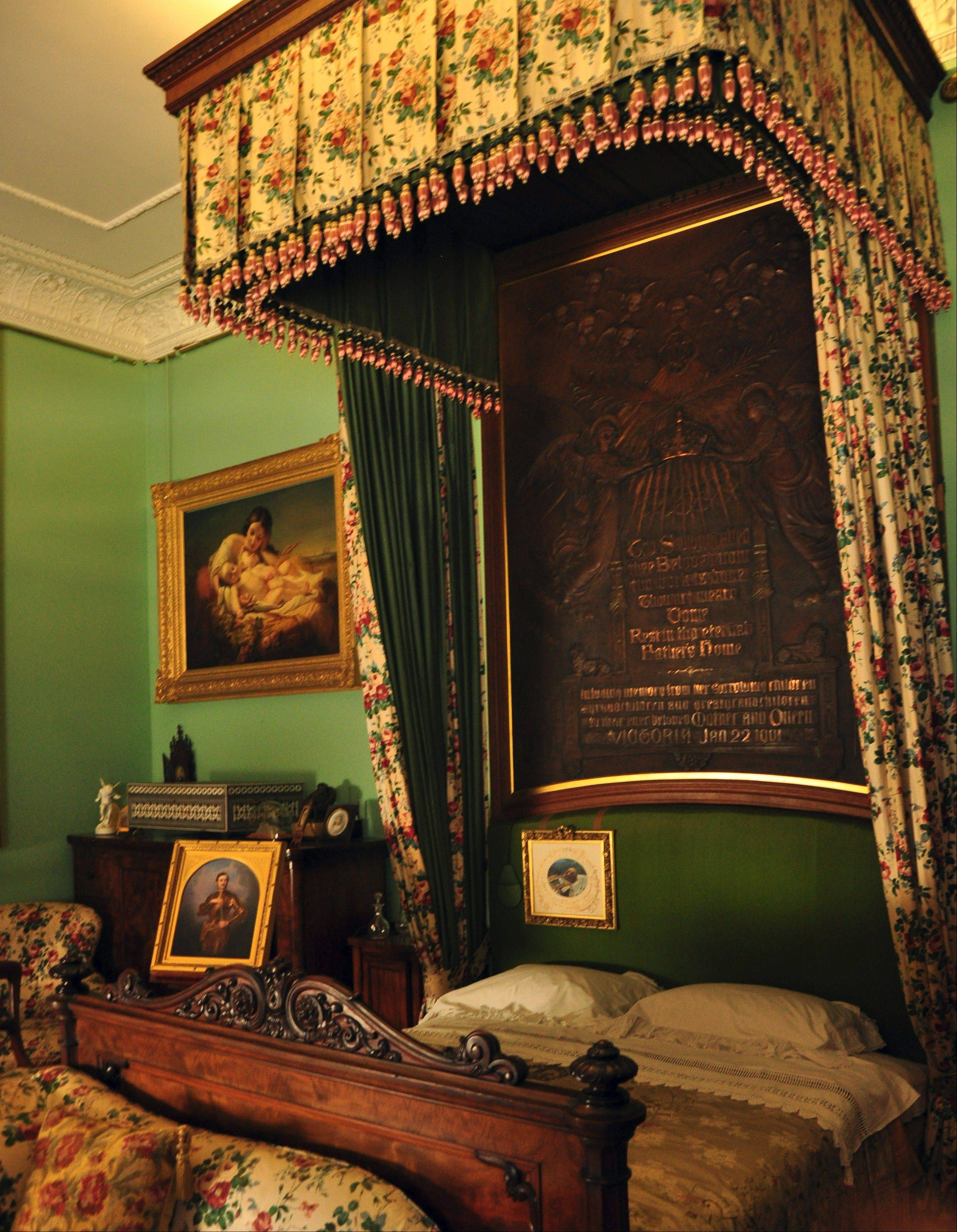 Queen Victoria died in her bedroom at Osborne House. Since Albert's death 40 years earlier, she kept his portrait on the headboard on his side of the bed.