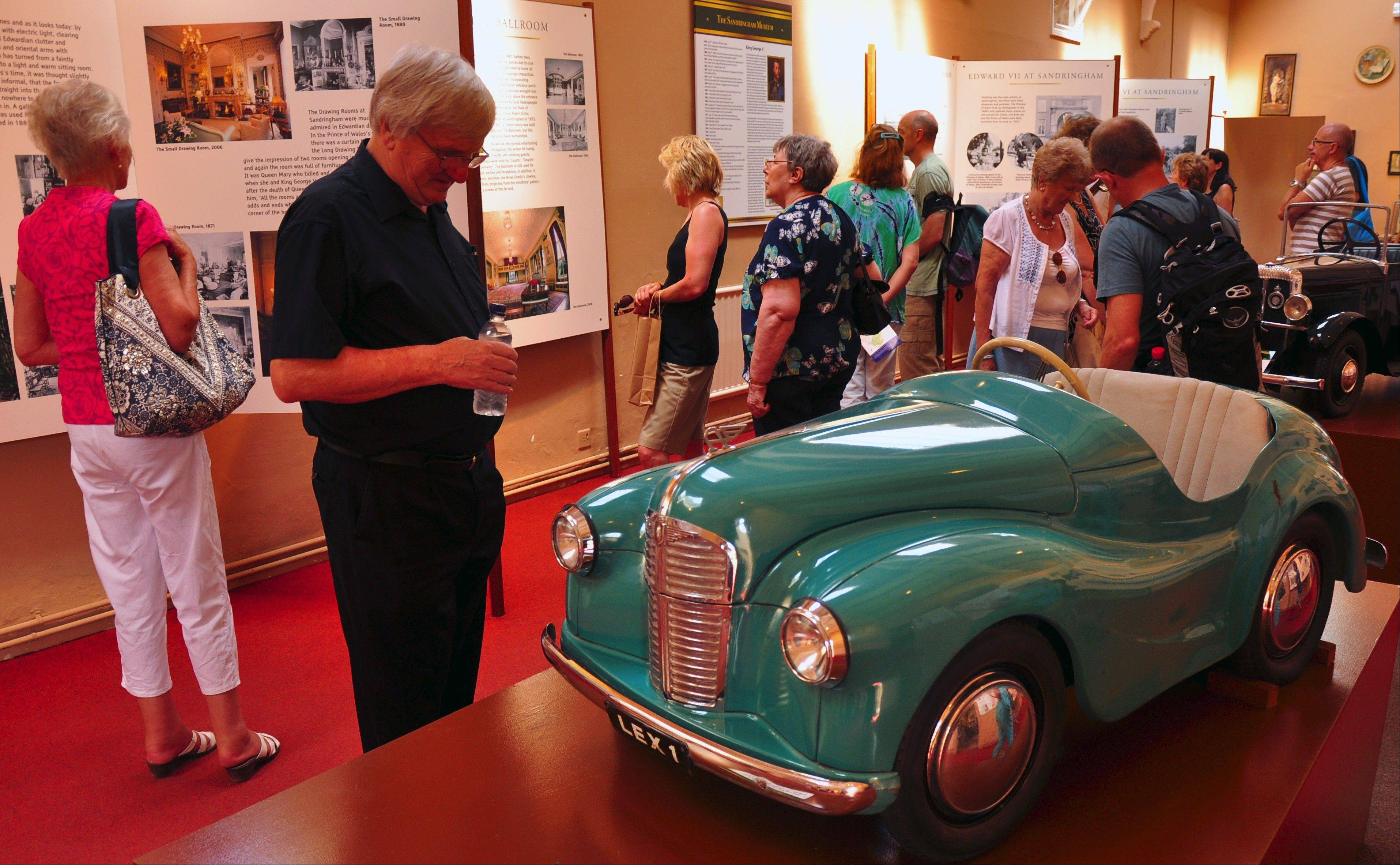 Miniature motorcars used by children in the royal family are on display in the Long Gallery of the museum at Sandringham.