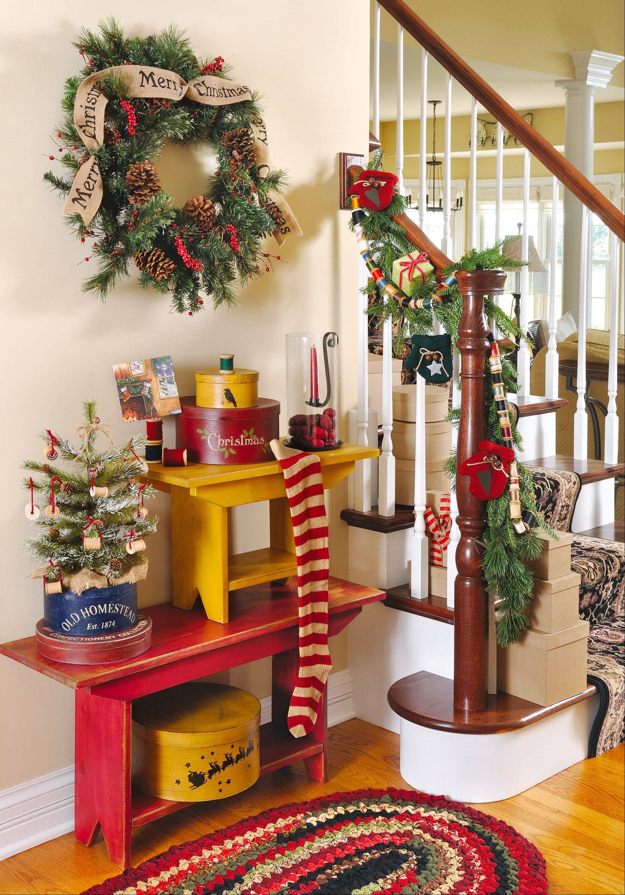 Spool party: For this foyer arrangement, the stylists centered the theme on a red-and-white-striped stocking.