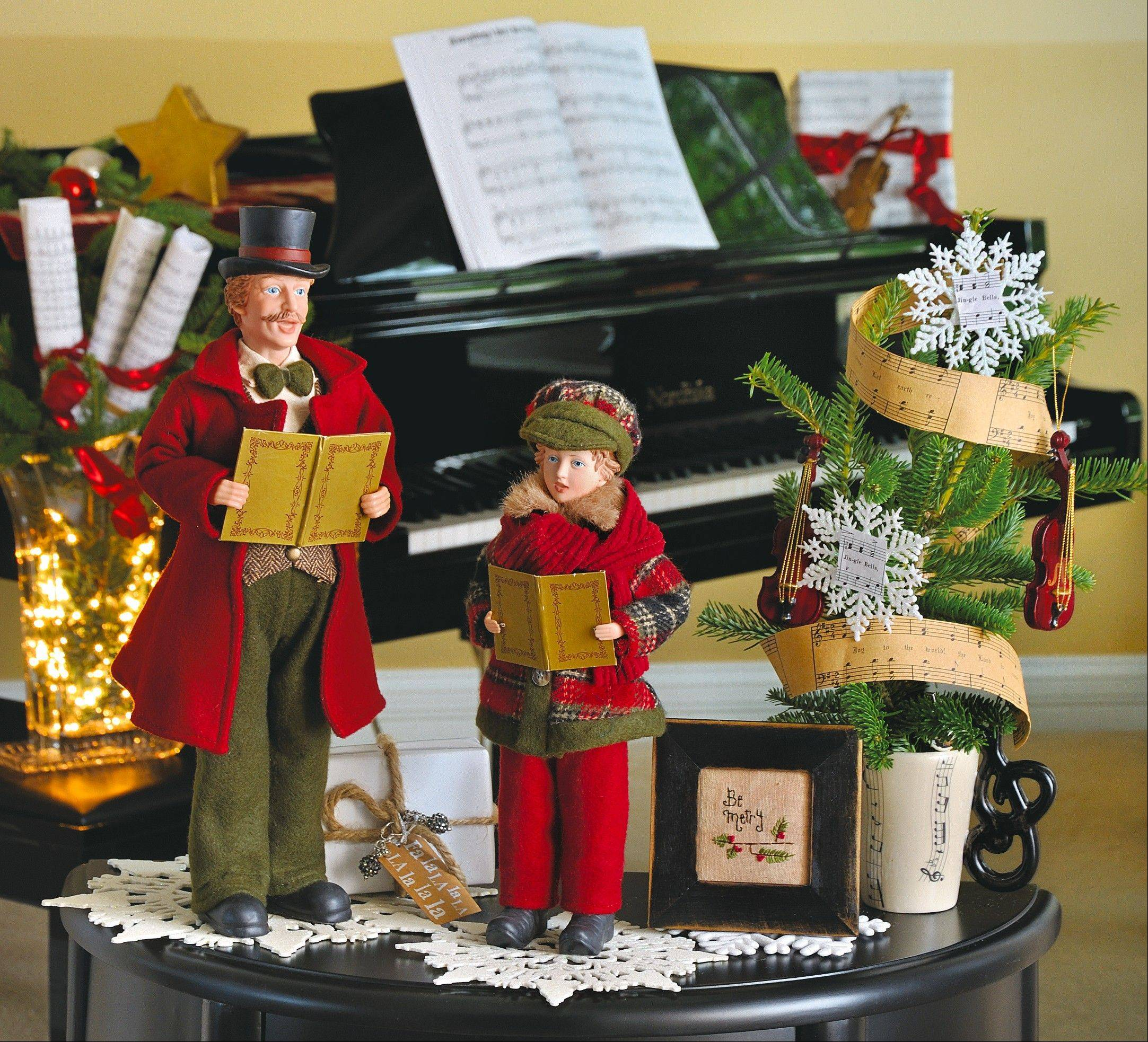 Music to my ears: These back-in-time caroler figures sound an old-fashioned note as the centerpiece of this musical vignette.