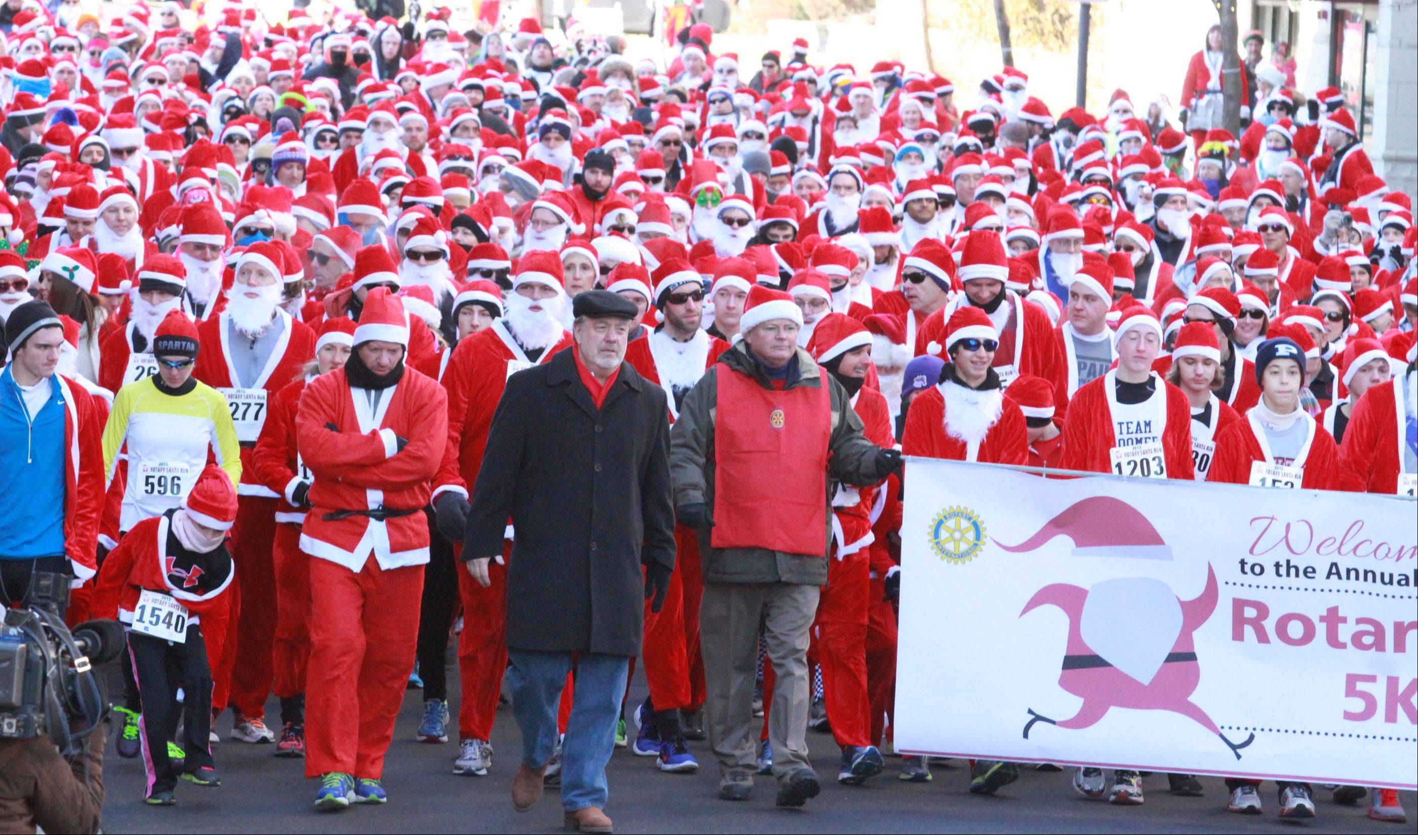 Over 1,600 runners started the Rotary 5K Santa run on Saturday by running the first block at Campbell Street and Vail Avenue in Arlington Heights.
