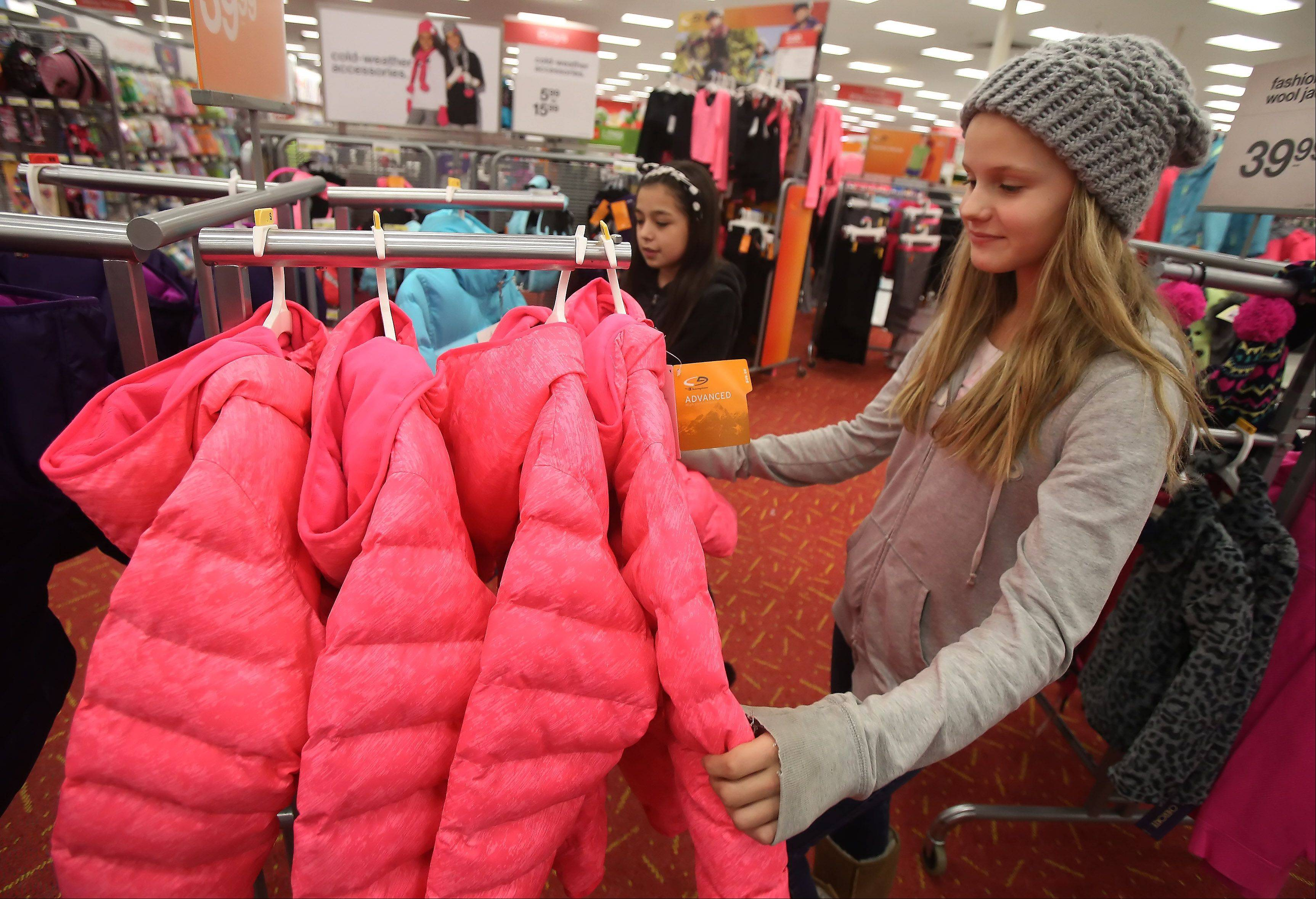Carl Sandbug Middle School seventh graders Shannon Lampi, right, and Jocelyn Gill, look for a coat at Target in Mundelein on Tuesday to help a needy Mundelein family.