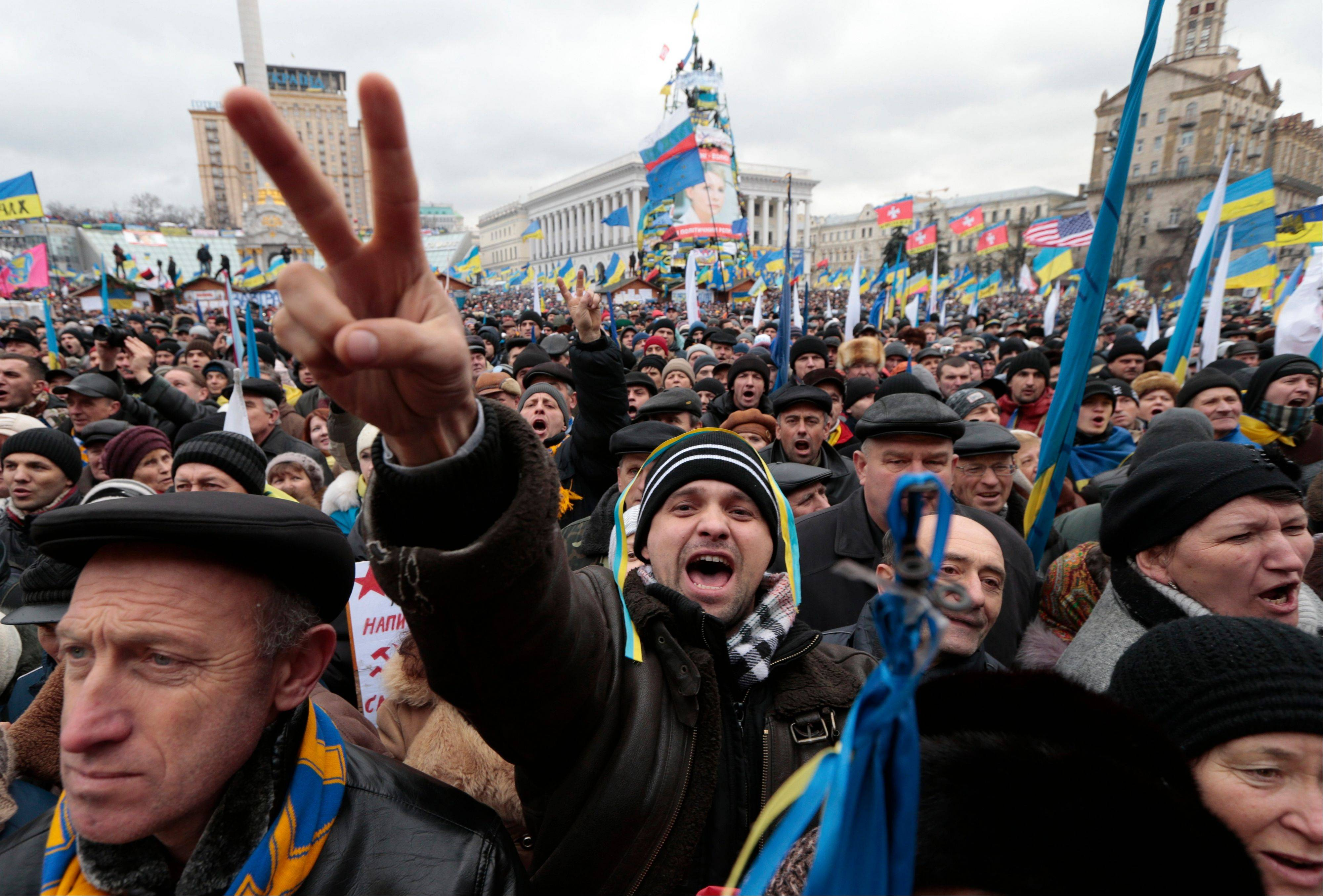 Pro-European Union activists shout slogans during a rally in the Independence Square, Kiev, Ukraine, Sunday. The third week of protests continue Sunday with an estimated 200,000 Ukrainians occupying central Kiev to denounce President Viktor Yanukovychís decision to turn away from Europe and align this ex-Soviet republic with Russia.
