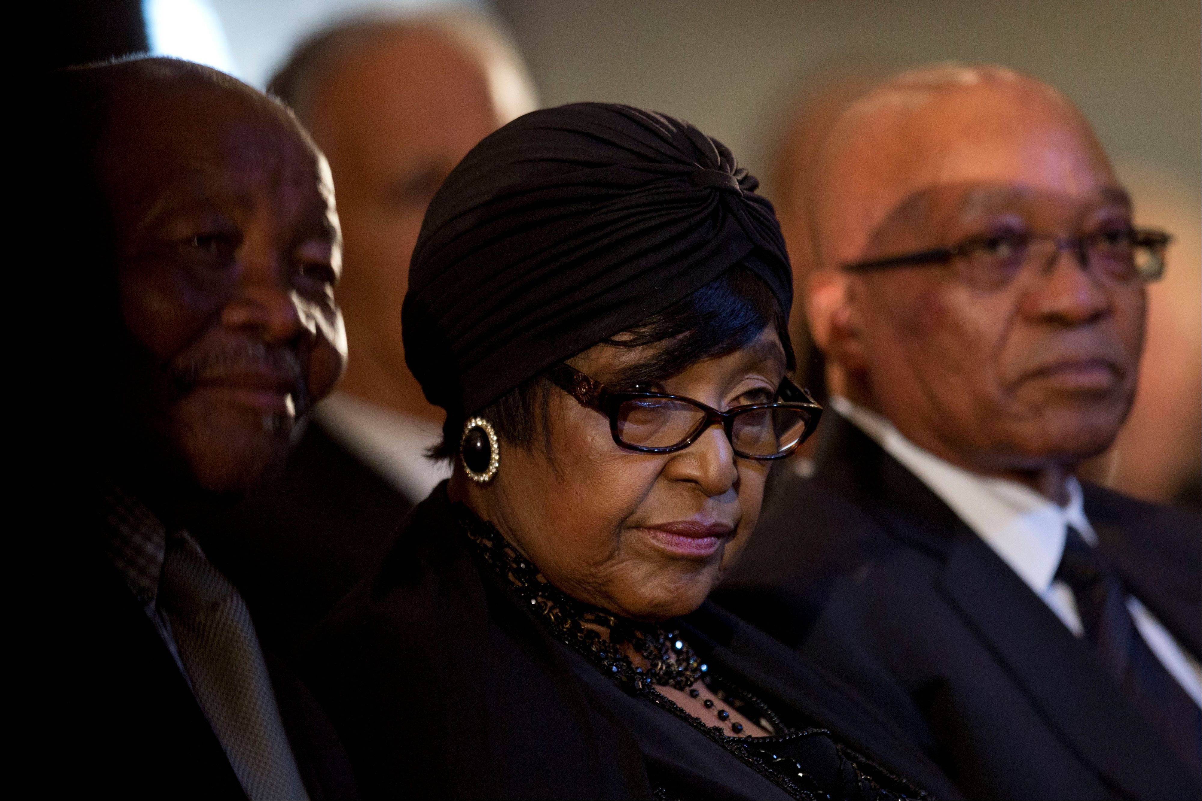 Winnie Madikizela-Mandela, Nelson Mandela's former wife, left, and South African President Jacob Zuma, right, attend a memorial service for Mandela at the Bryanston Methodist Church in Bryanston suburb of Johannesburg, South Africa, Sunday. South Africa is readying itself for the arrival of a flood of world leaders for the memorial service and funeral for Nelson Mandela.