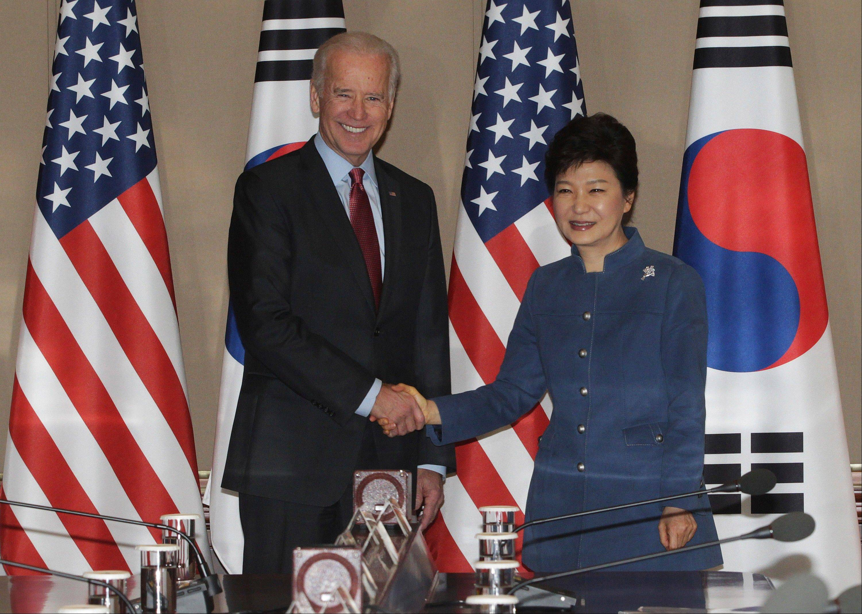South Korean President Park Geun-hye, right, shakes hands with U.S. Vice President Joe Biden before their meeting at the presidential Blue House in Seoul, South Korea, Friday.