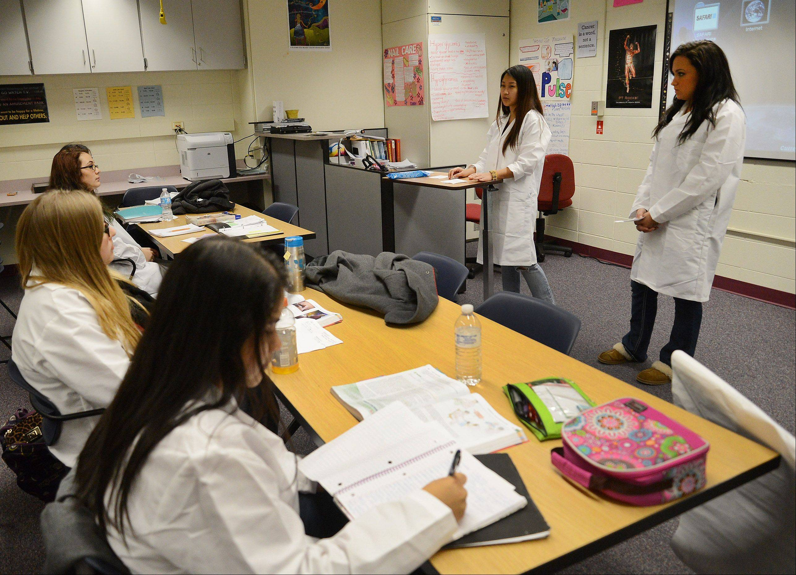 Students conduct presentations in the nursing lab classroom, part of the STEM curriculum at Wheeling High School.