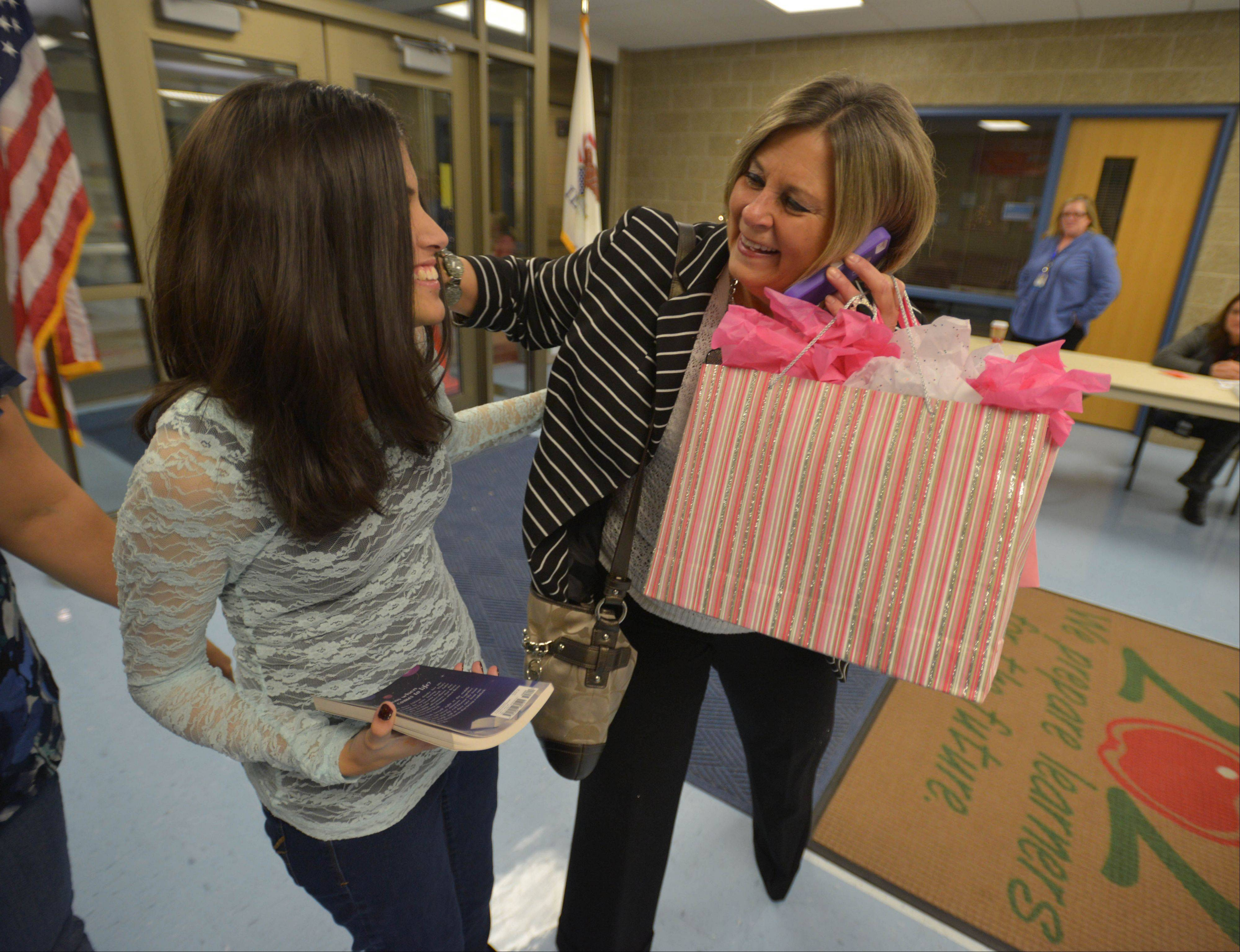 Make-A-Wish volunteer wish-granter Cindy Kepner arrives with gifts for Ravina Thakkar, as the girl celebrates her 14th birthday and the publication of her first novel.