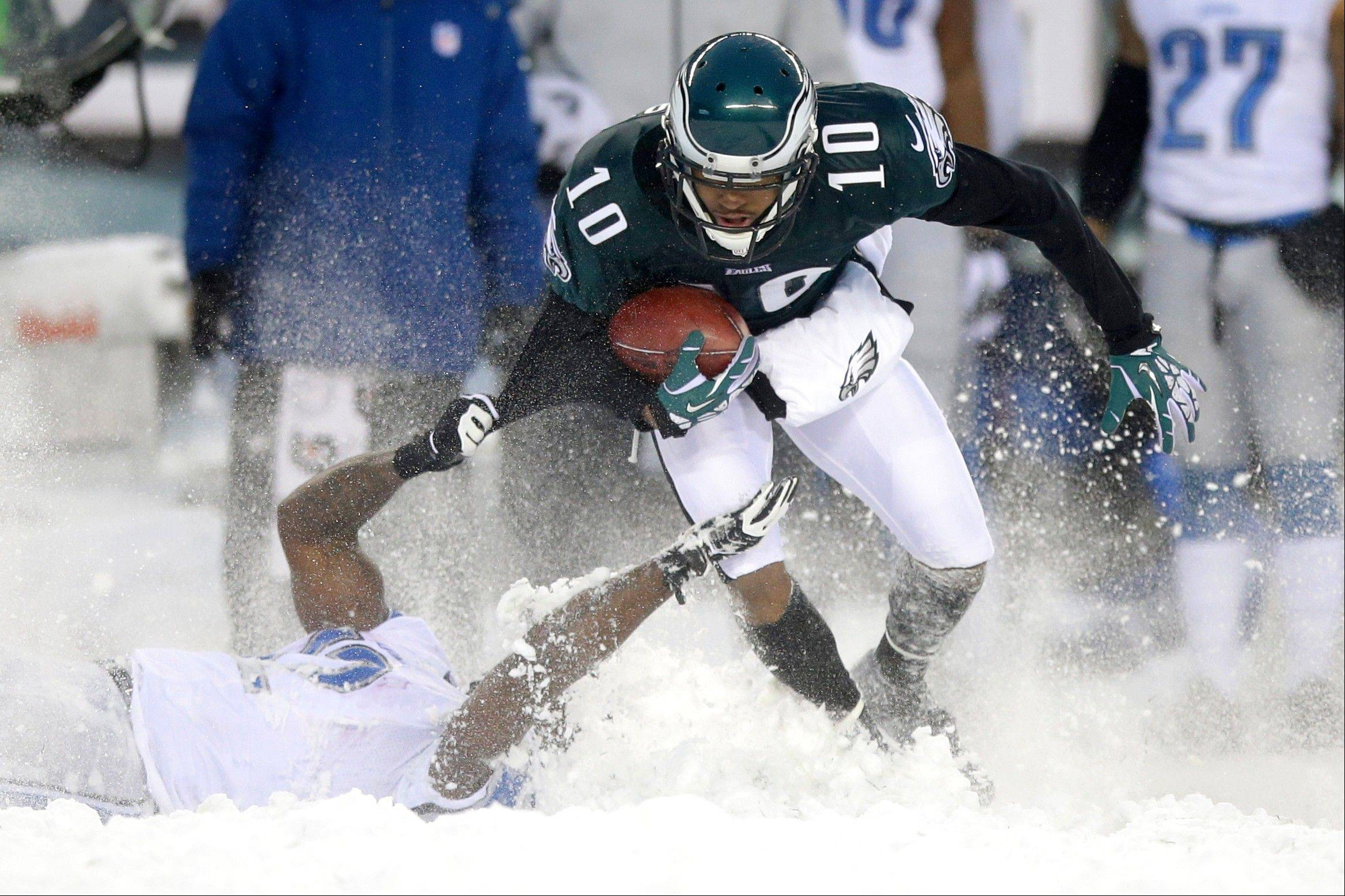 Philadelphia Eagles' DeSean Jackson (10) is tackled by Detroit Lions' Jeremy Ross (12) during the second half of an NFL football game, Sunday, Dec. 8, 2013, in Philadelphia.