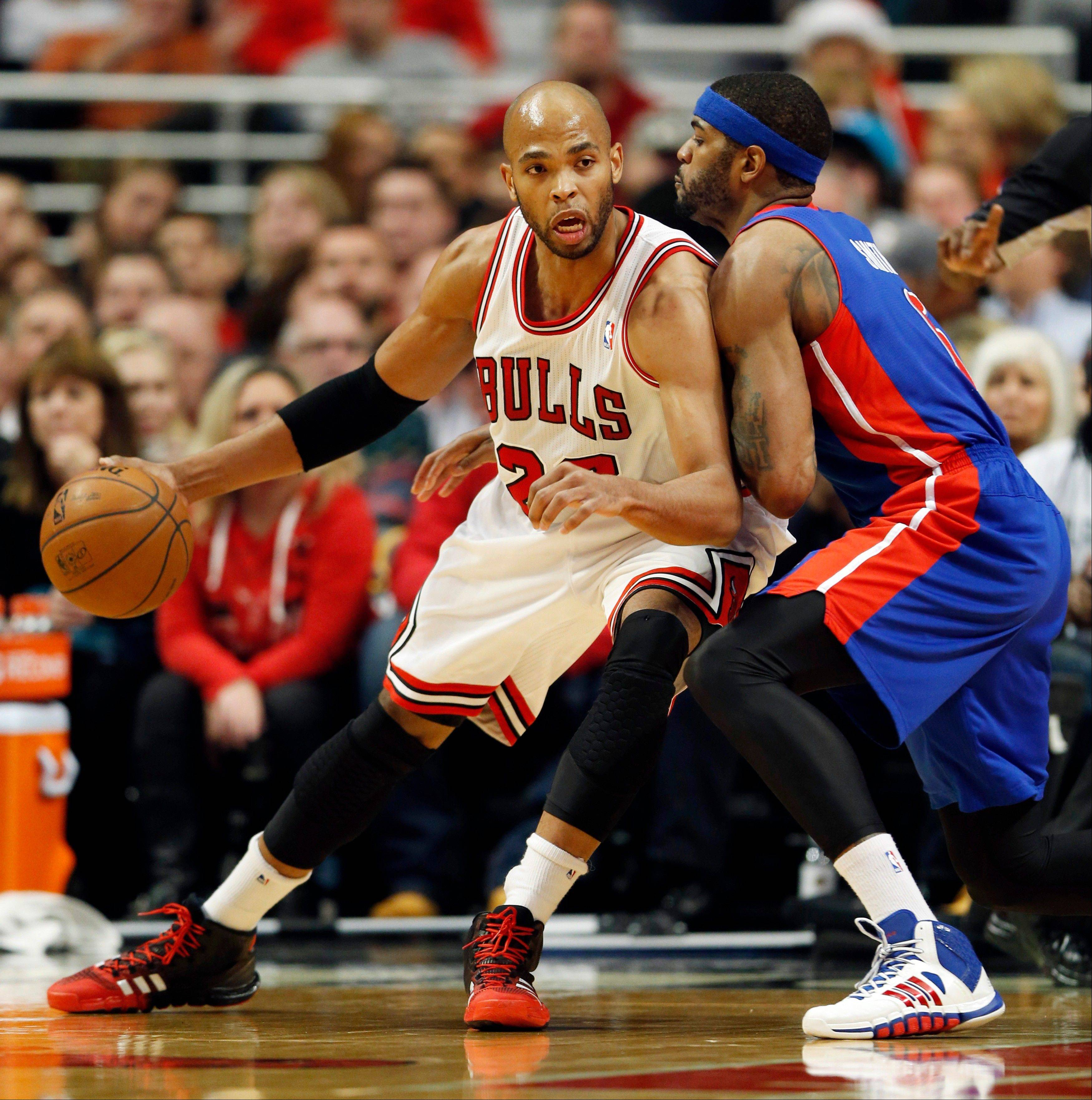 Detroit Pistons forward Josh Smith, right, defends against Bulls forward Taj Gibson on Saturday night at the United Center.