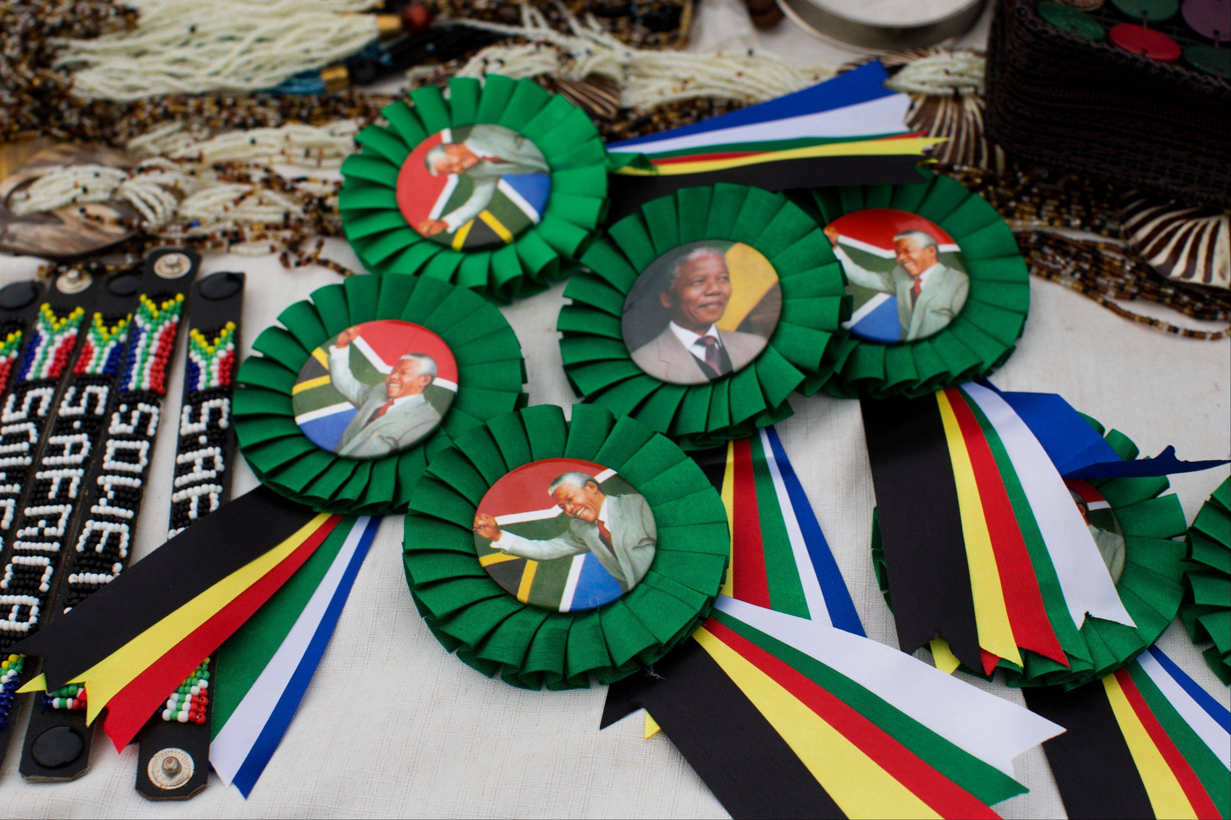 Badges for sale with the image of late president Nelson Mandela in Soweto, Johannesburg, South Africa, Monday.