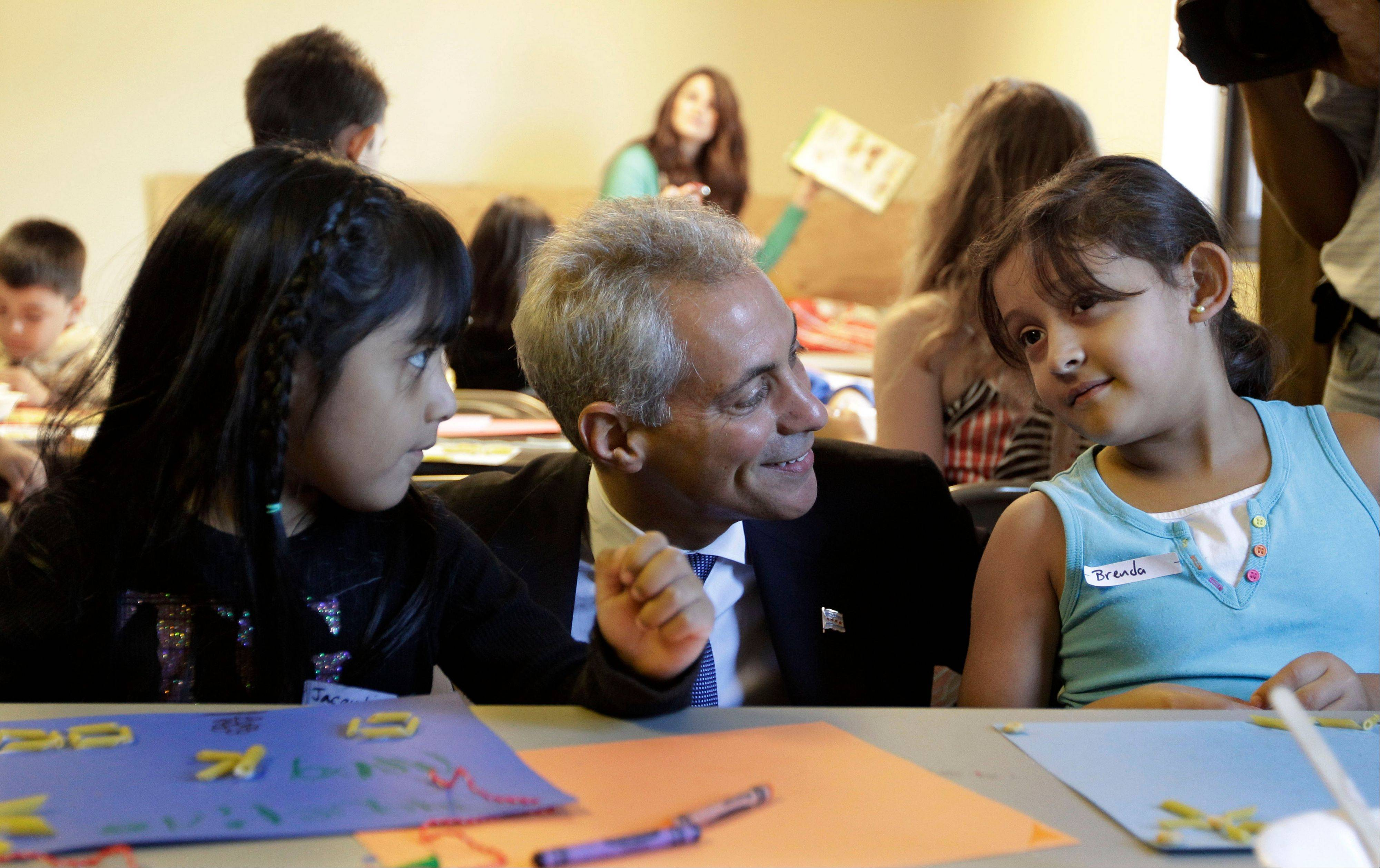 This Sept. 10, 2012, file photo shows Chicago Mayor Rahm Emanuel visiting with students at Maranatha Church in Chicago, where students were being provided structured activities during a teachers strike. Mayor Emanuel has said if the Illinois Legislature — which passed a historic measure last week to address the stateís worst-in-the-nation public pension shortfall — doesn't deal with Chicago's own multibillion-dollar pension problem next, city services could suffer in the future, with more teachers losing their jobs.