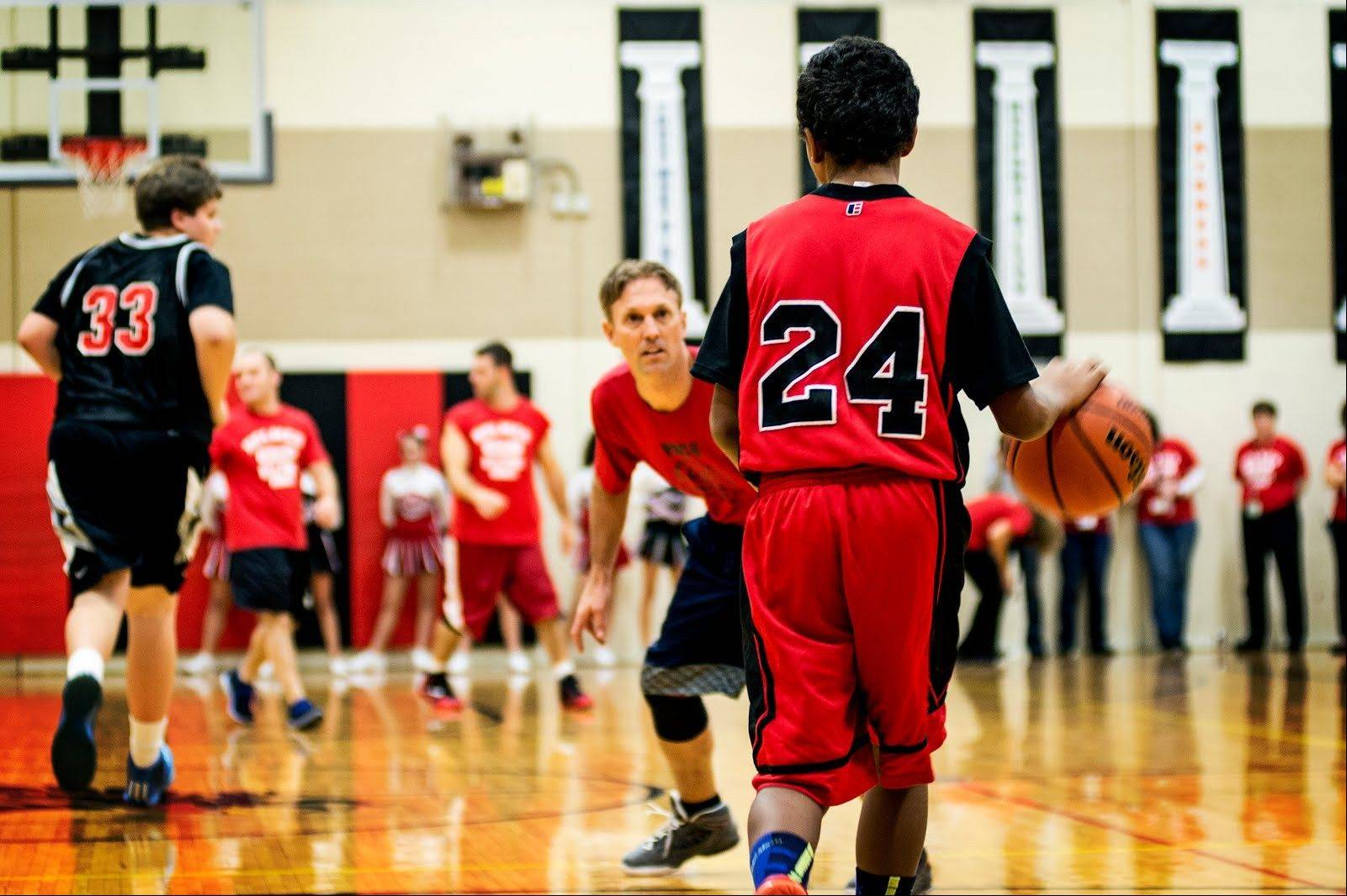 Students and faculty play in the third annual �Holmes Helping Homes� Basketball Charity Event on Nov. 20. Money raised helps needy families in the Holmes Jr. High community.