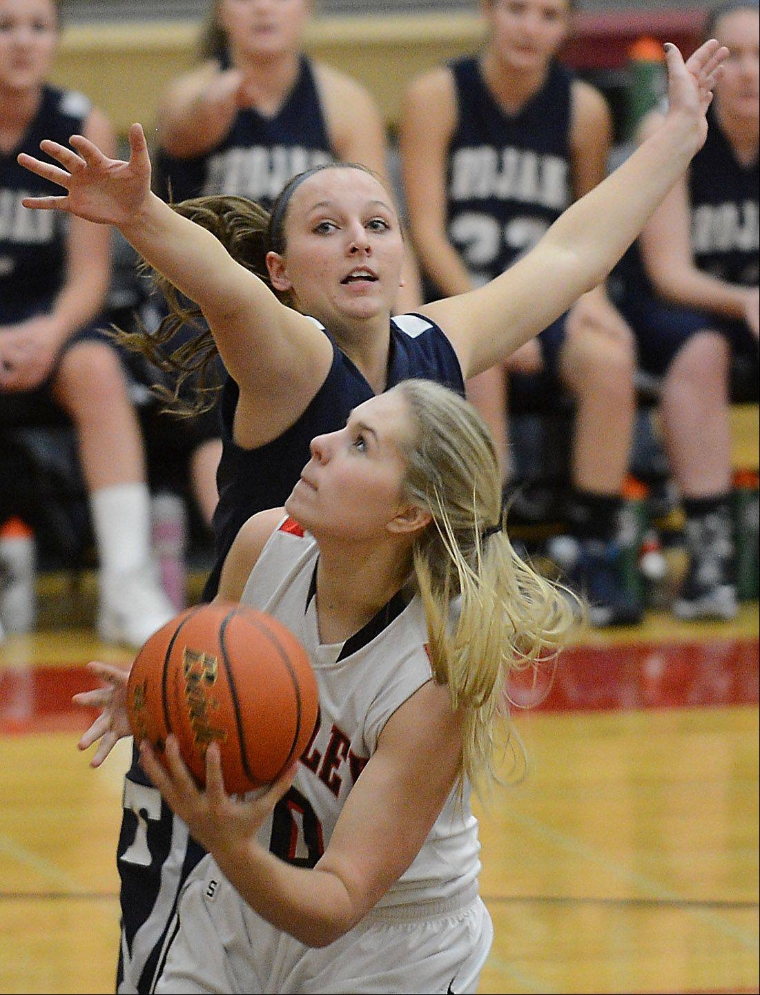 Huntley�s Ali Andrews (50) looks for a shot while being defended by Cary-Grove�s Karisa Wilczynski (5) during Monday�s game in Huntley.