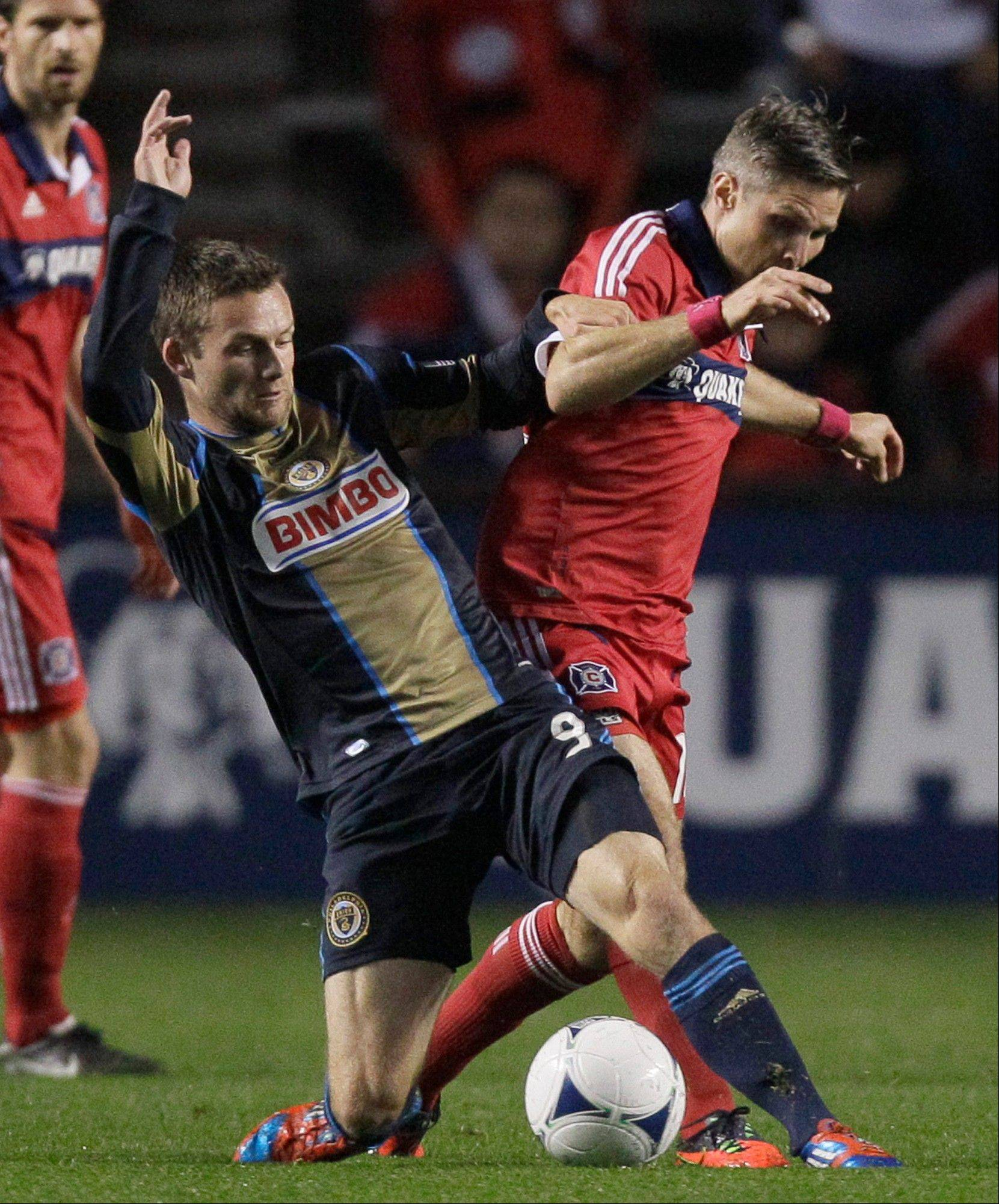 Chicago Fire officials declined to pick up the contract option for midfielder Logan Pause, right, for the 2014 season. The club could opt to bring him back under a new contract, however.
