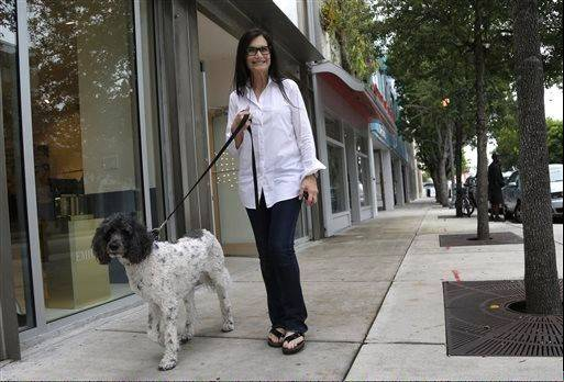 Gallery owner Deborah Sponder walks her dog in the Design District neighborhood of Miami. It's not just the wealthiest 1 percent: Fully 20 percent of U.S. adults become rich for parts of their lives, wielding outsized influence on America's economy and politics.