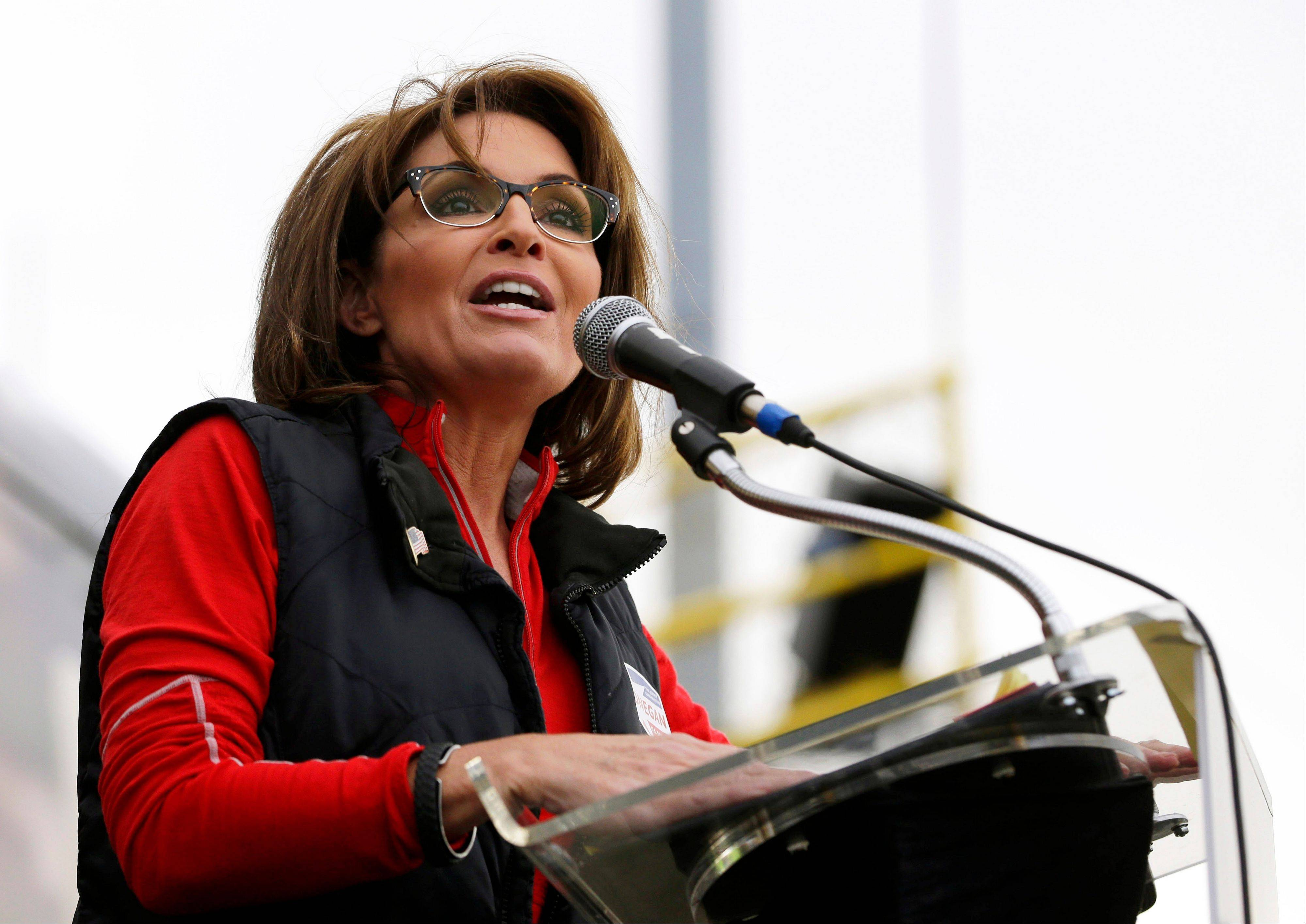 "The Sportsman Channel said Monday it has hired Sarah Palin to be host of a weekly outdoors-oriented program that will celebrate the ""red, wild and blue"" lifestyle. The program, ""Amazing America,"" will debut next April."