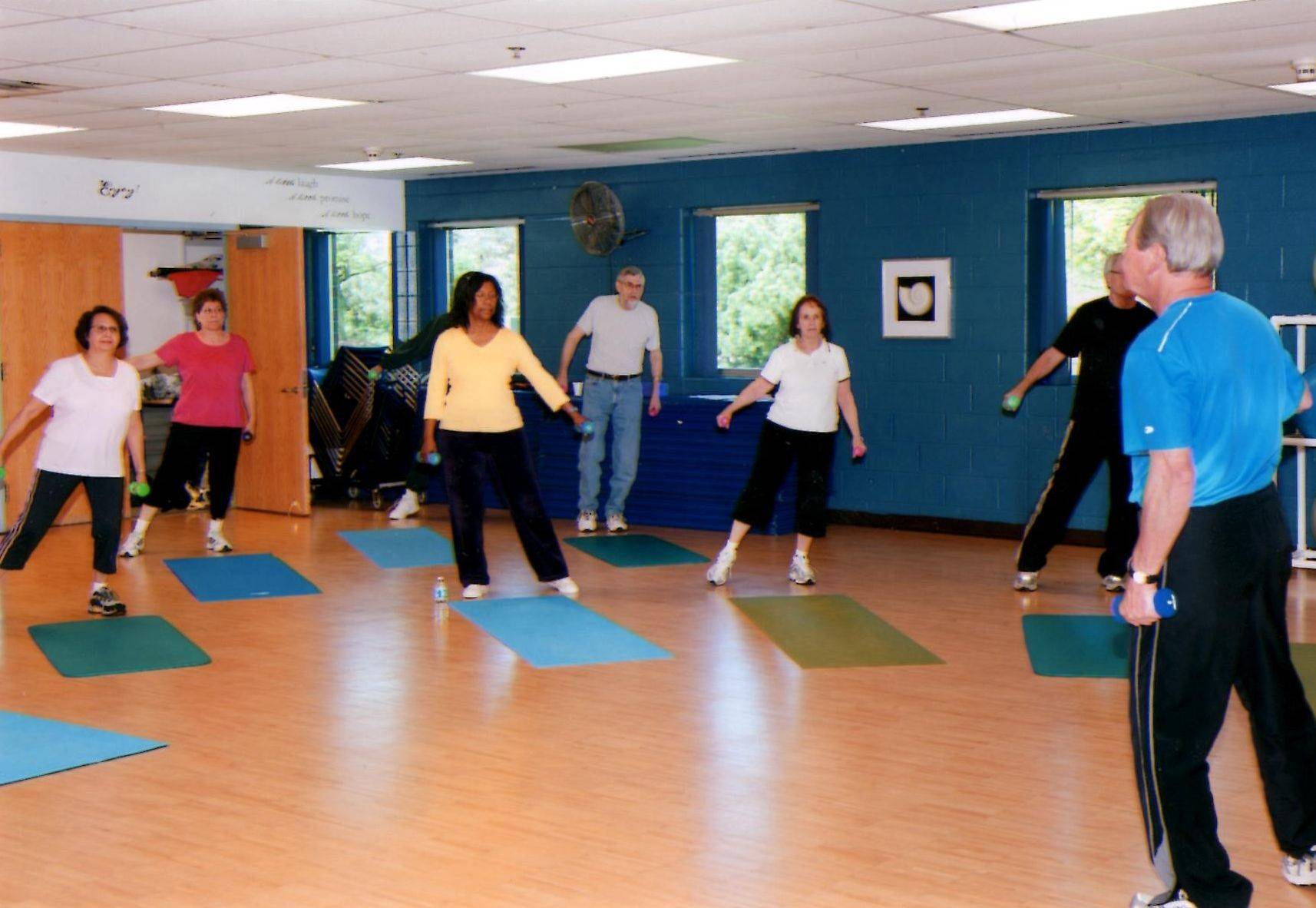 John Keller leads a senior fitness class in resistance band exercises. Keller and Bernie Klos have opened Rehabitations, Inc. in Libertyville, which offers fitness classes for seniors, priced at just $3 a class.