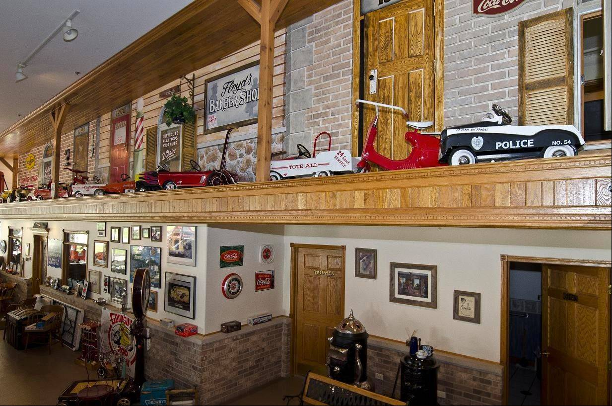 A back wall in the shop displays a mural and Getzelman's pedal car collection.