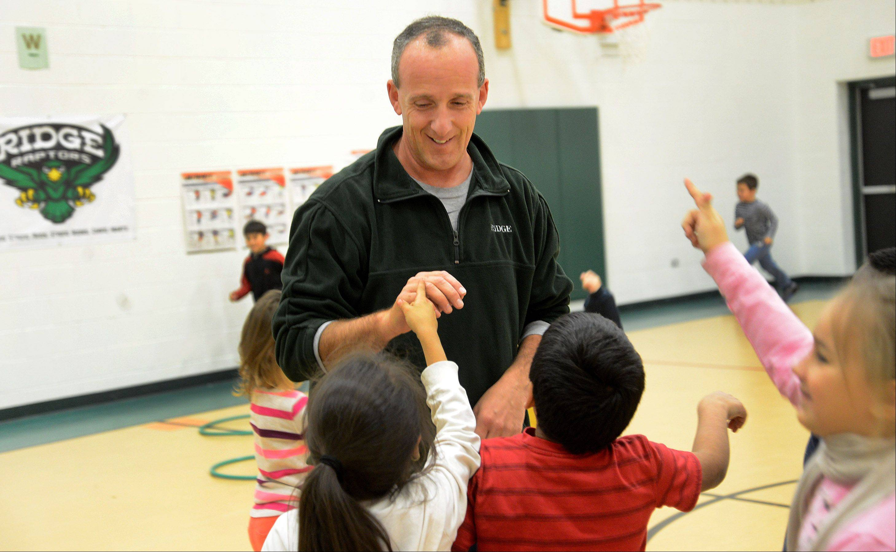 "Will Hogan, a physical education teacher at the Ridge Family Center for Learning in Elk Grove Township Elementary District 59, is being recognized by the Daily Herald as one of ""The Suburbs' Top Teachers."""