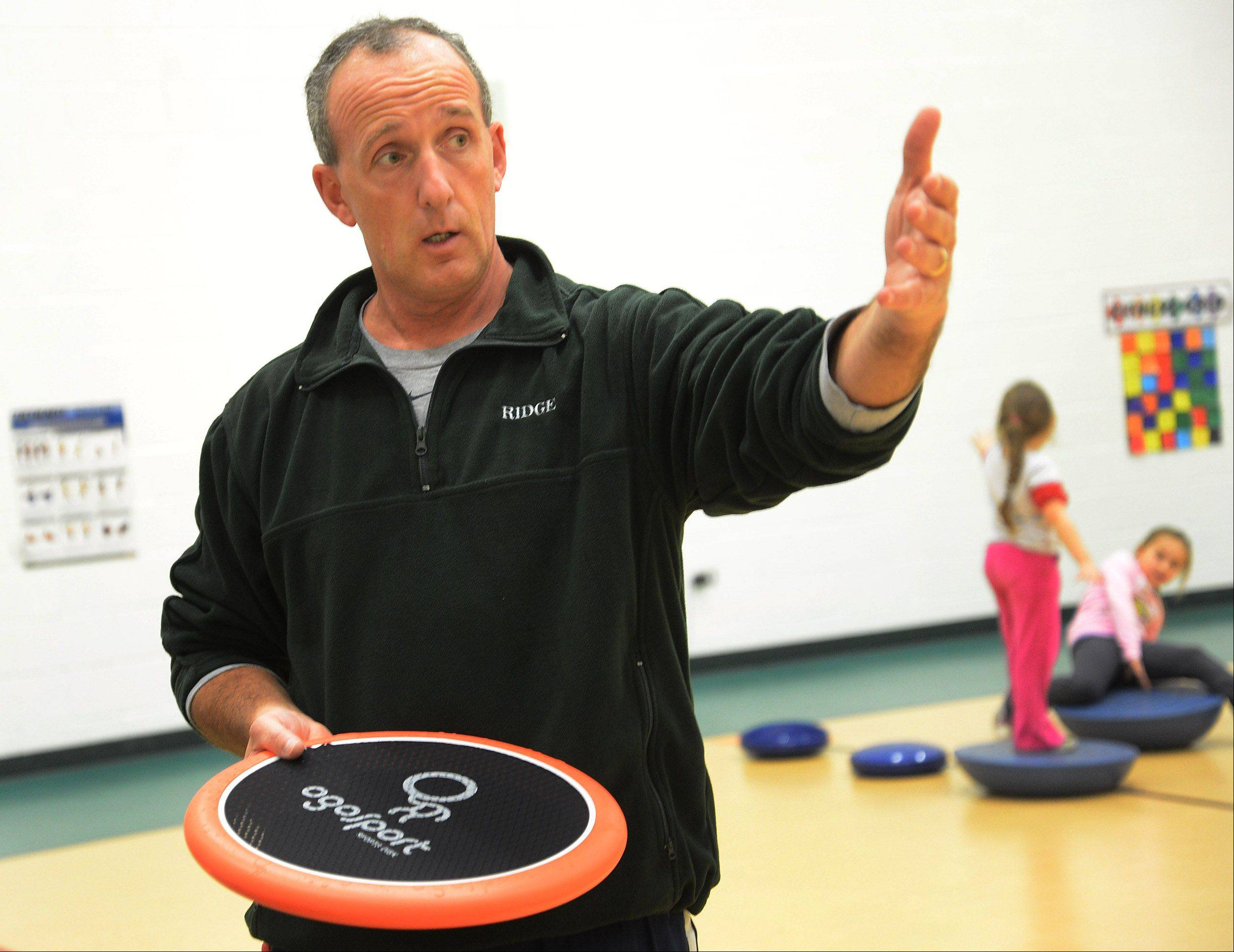 "Ridge Family Center for Learning physical education teacher Will Hogan says that while some schools have ""gutted P.E. ... research shows it's not an either/or proposition."" Hogan is the driving force behind the Elk Grove school's efforts to promote daily physical fitness and nutritional awareness -- efforts that have been recognized nationally."