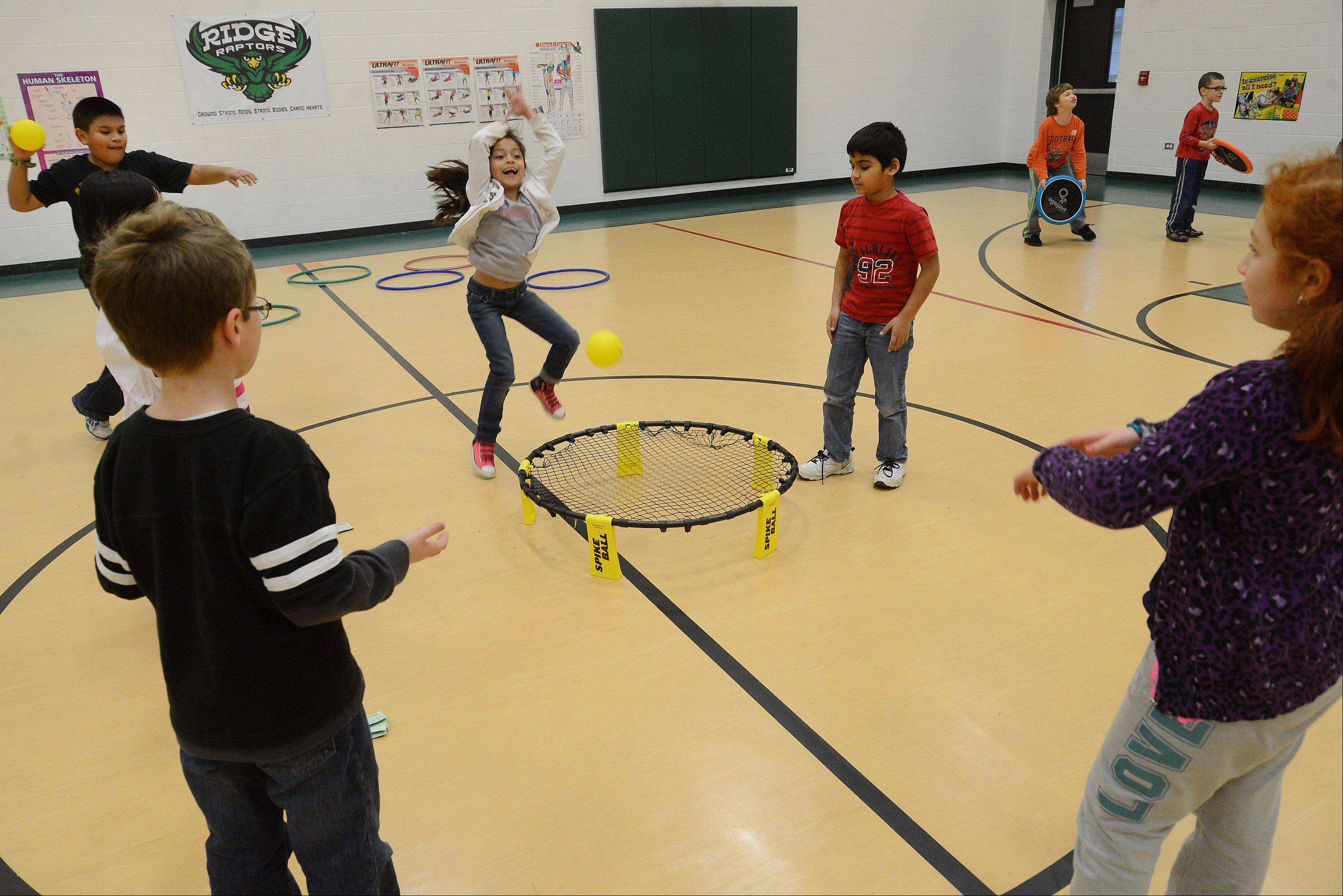 "Students in Will Hogan's gym class at Ridge Family Center for Learning in Elk Grove Village play Spikeball -- a 3-minute payoff for Hogan's cardio-intensive ""Dash for Cash"" workout."