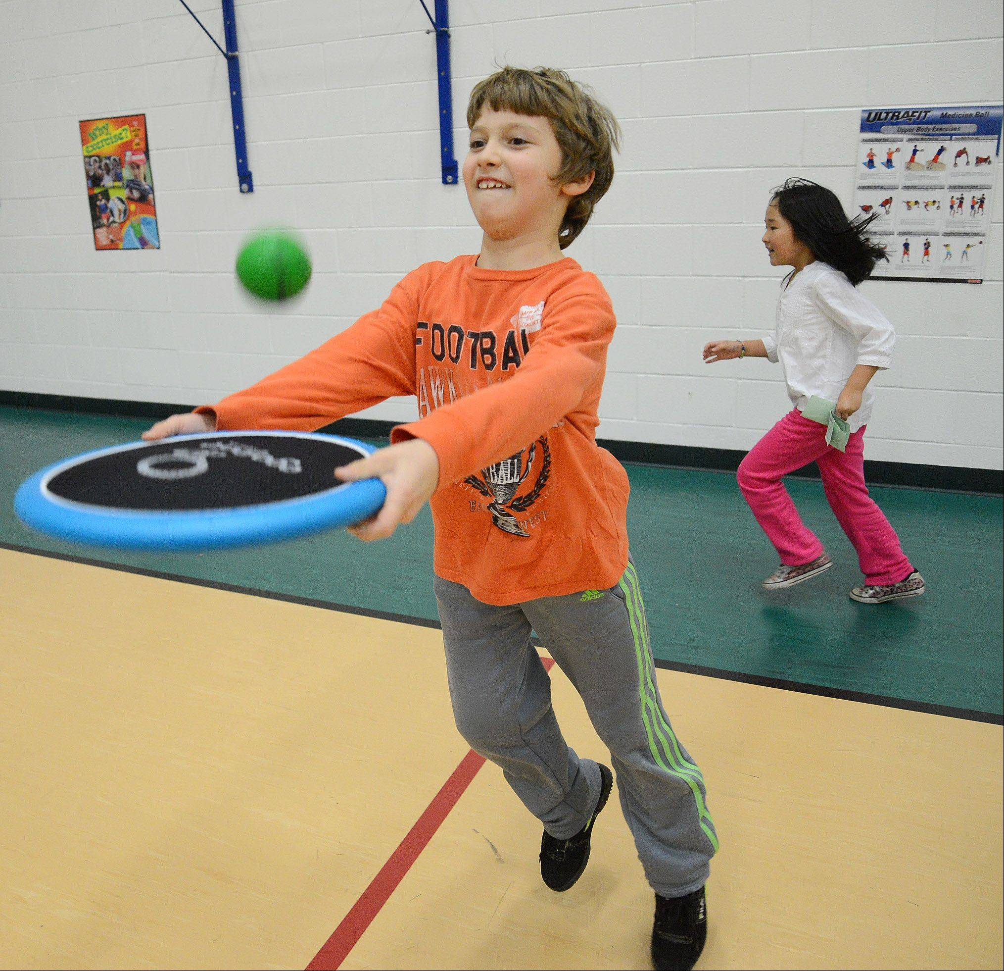 Ivan Popov plays with the OgoSport disk game during one of Will Hogan's recent P.E. classes at the Ridge Family Center for Learning in Elk Grove Village.