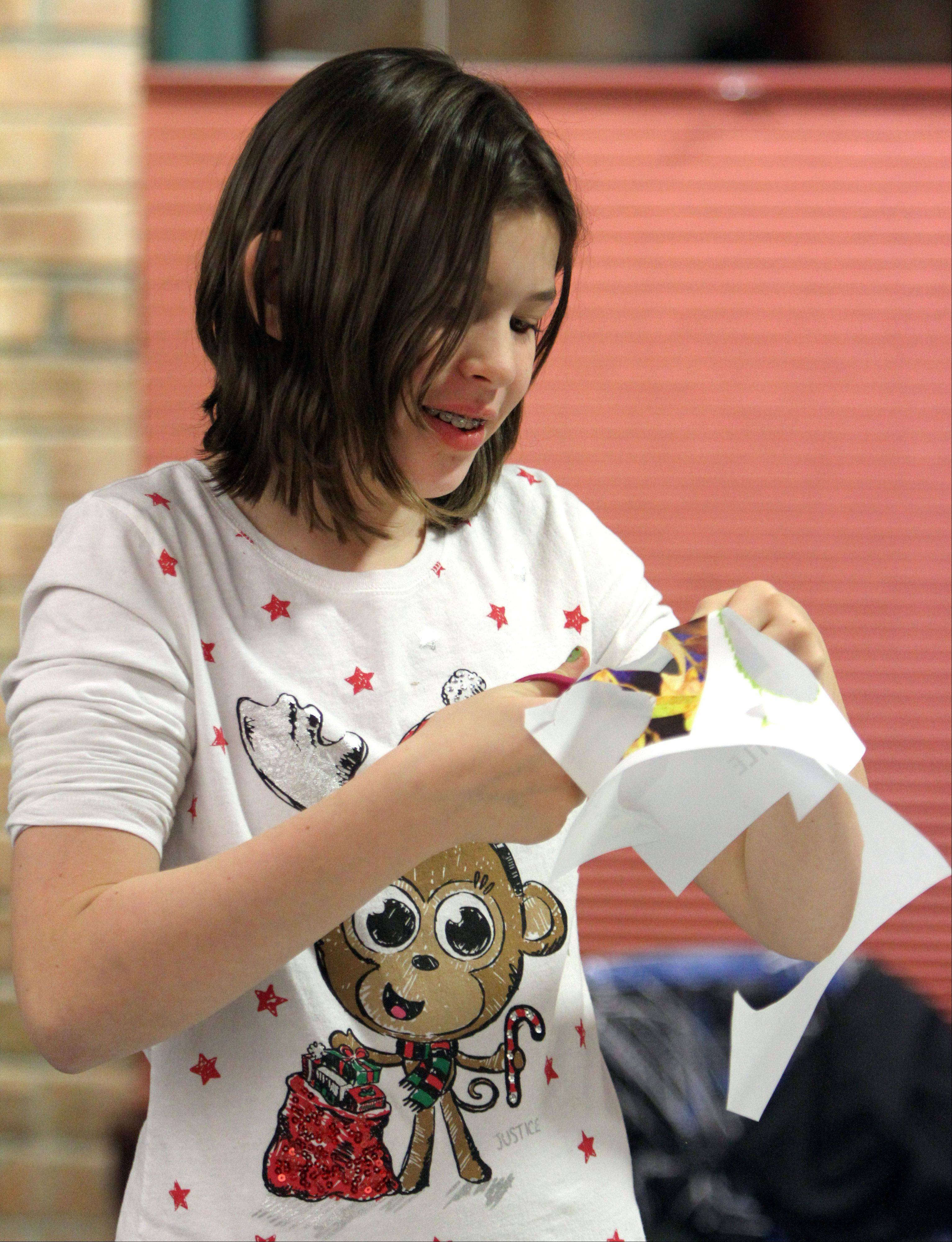Twelve-year-old Monika Siedler of Round Lake Beach cuts out pictures of leaves as kids grades 4-6 participated in an art program Monday called Artful Inspirations at the Lake Villa District Library.