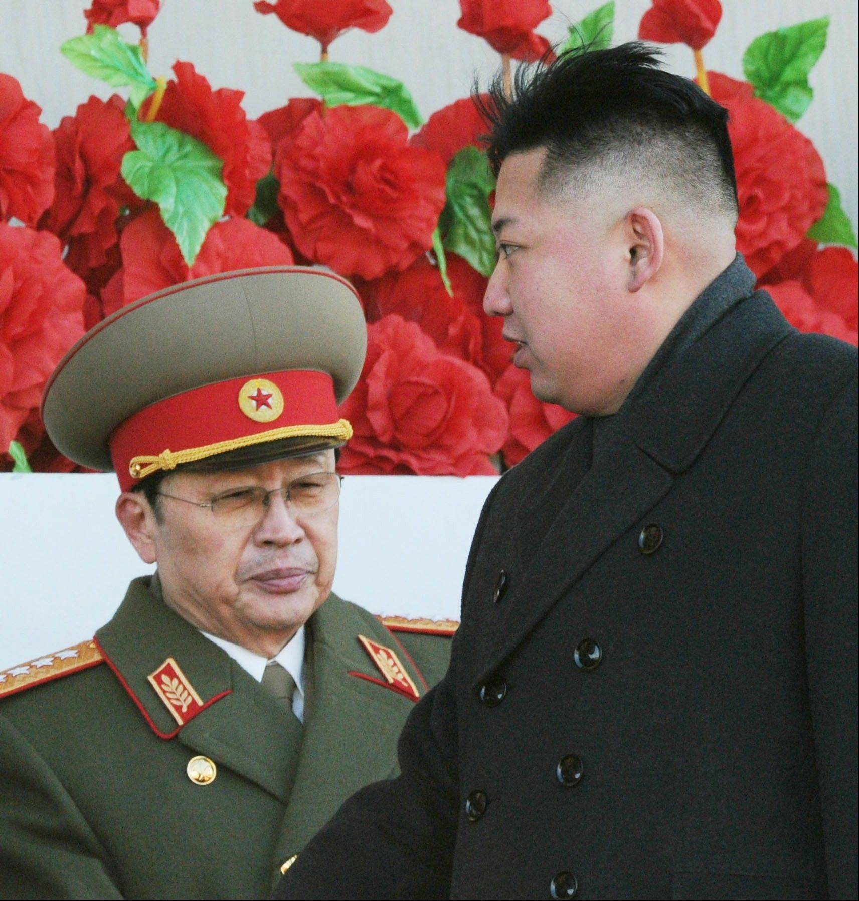In this Feb. 16, 2012, photo, North Korean leader Kim Jong Un walks past his uncle Jang Song Thaek, left, after reviewing a parade of thousands of soldiers and commemorating the 70th birthday of the late Kim Jong Il in Pyongyang.