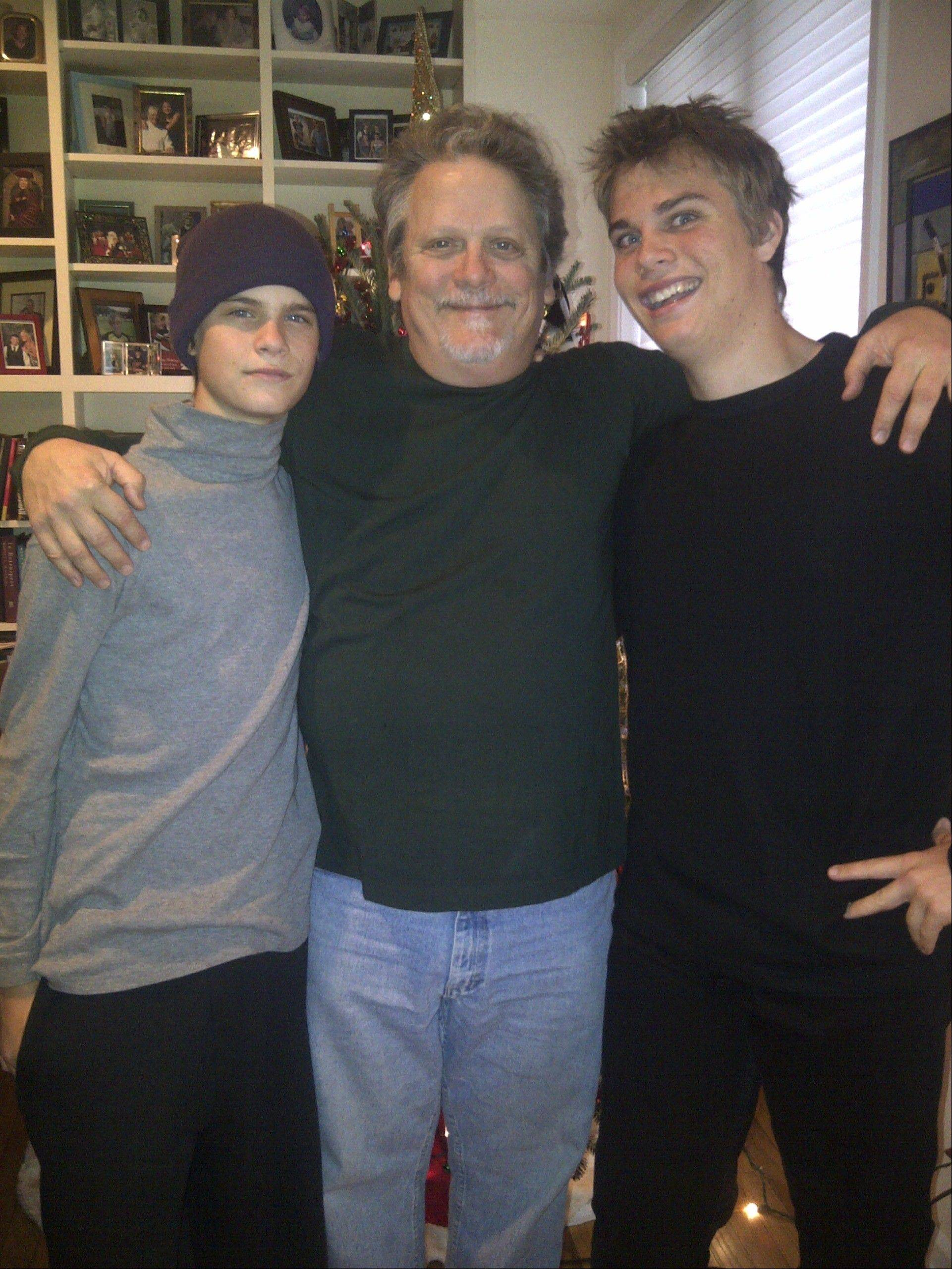 "Actor Keith Szarabajka, formerly of Arlington Heights, poses with his two sons at his home in Los Angeles. Szarabajka, a Hersey High School alumnus, has starred in dozens of well-known movies and TV shows, including ""The Dark Knight, ""Argo"" and ""Cold Case."""