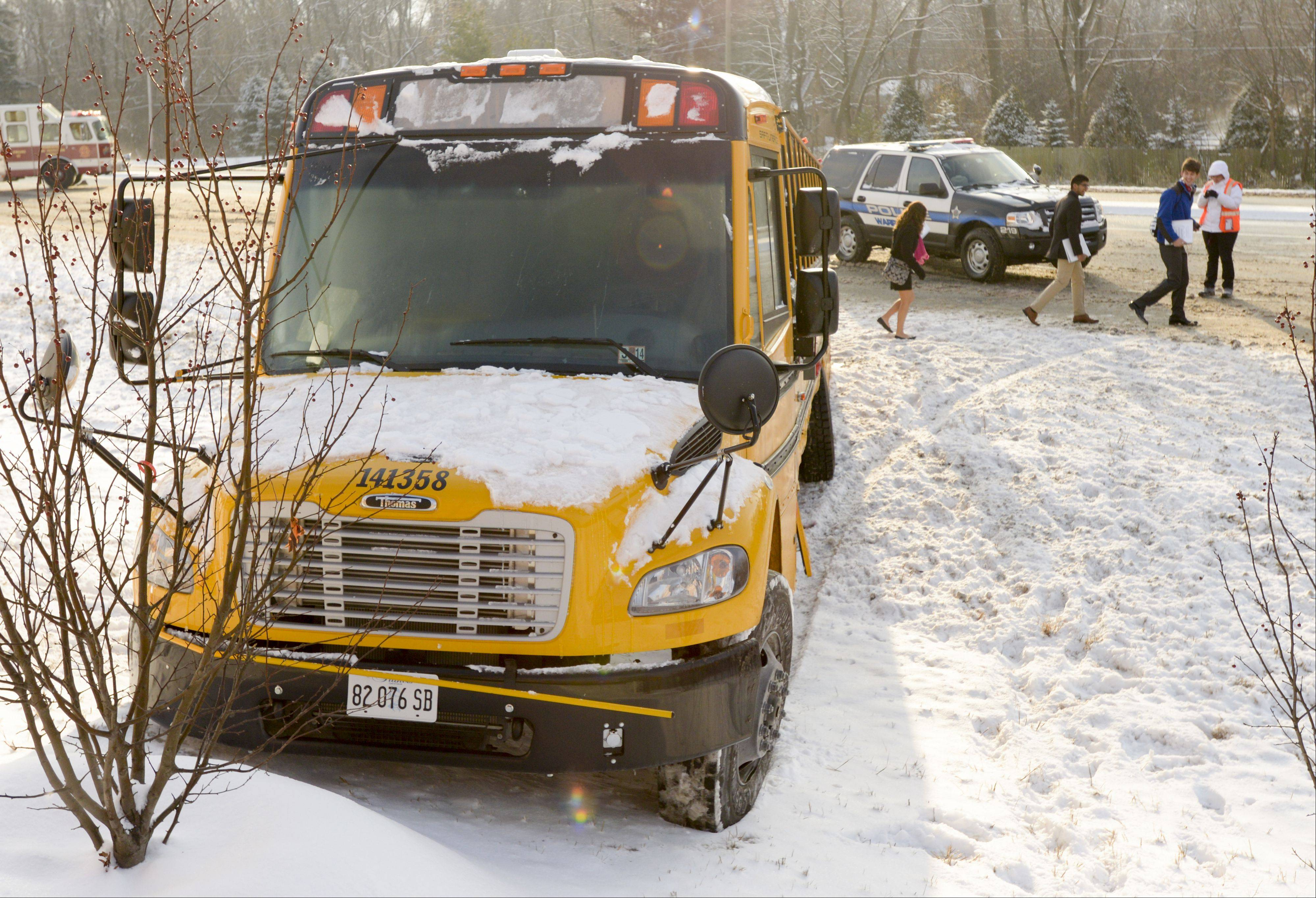 Students exit a school bus Monday morning after it came to rest in a ditch along Butterfield Road near Route 59 in Warrenville. The bus, carrying students from Metea Valley and Waubonsie Valley high schools, was struck by a Ford Explorer and sent spinning off the road. None of the students were injured, but the driver of the Explorer was transported to Central DuPage Hospital complaining of neck pains.