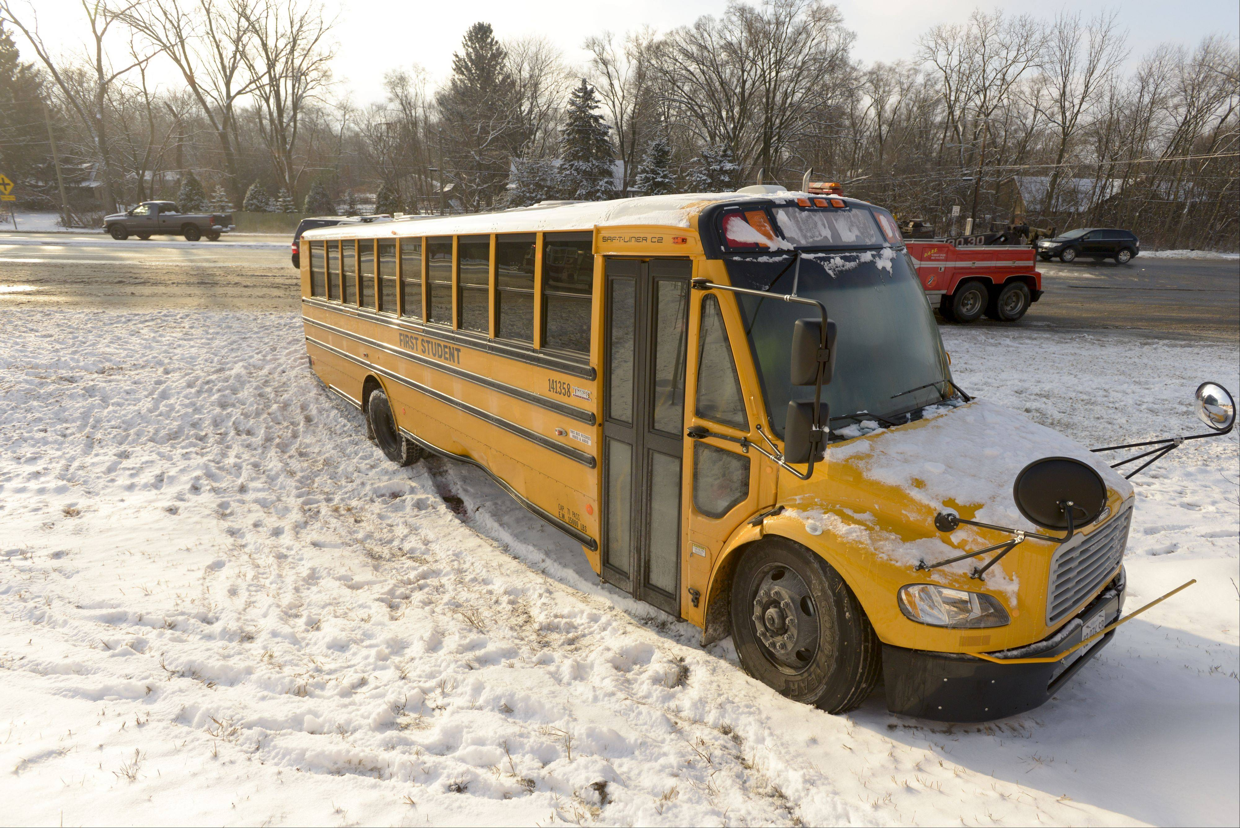 A school bus transporting students from Metea Valley and Waubonsie Valley high schools in Aurora to an event at Elmhurst College was struck by a Ford Explorer and sent spinning into a ditch Monday in Warrenville. No students were injured.
