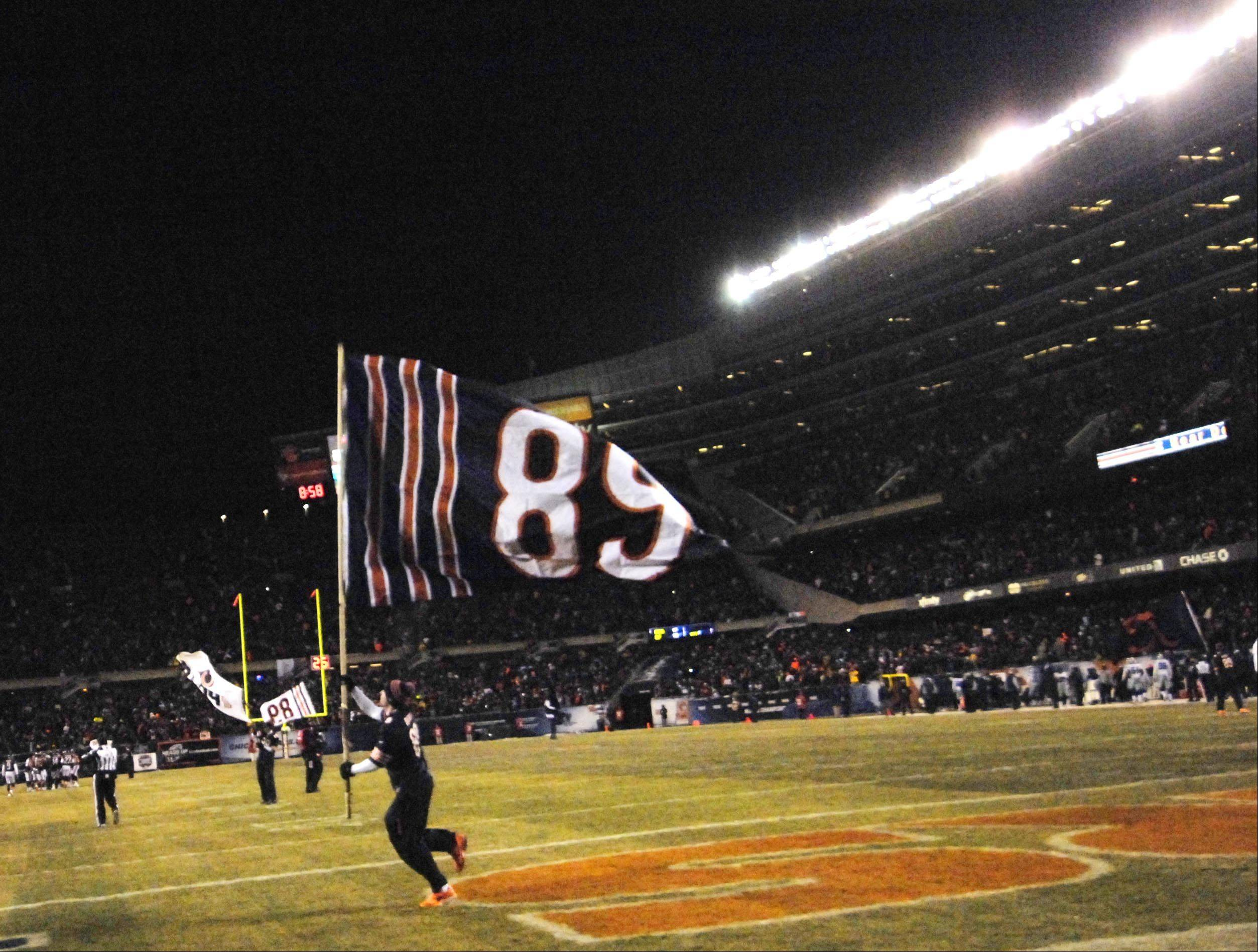 Mike Ditka's jersey number is waved on a flag Monday at Soldier Field in Chicago.