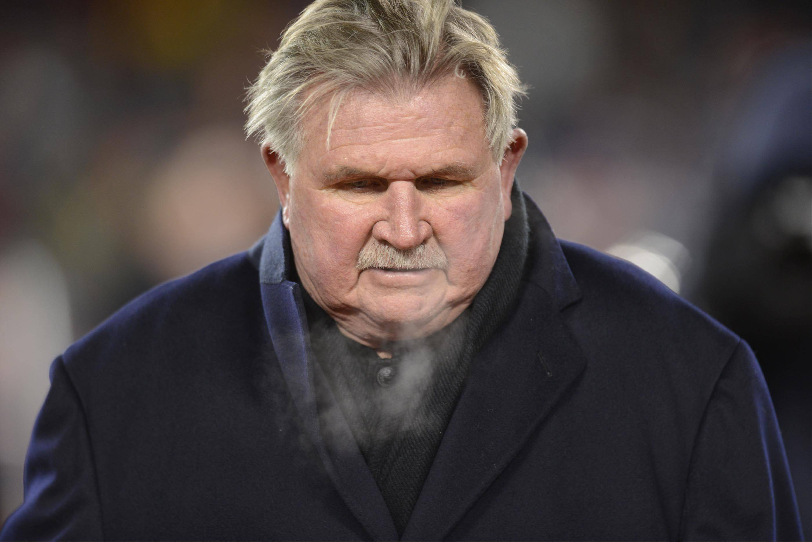 Former Chicago Bears coach Mike Ditka leaves the field after his number retirement ceremony.