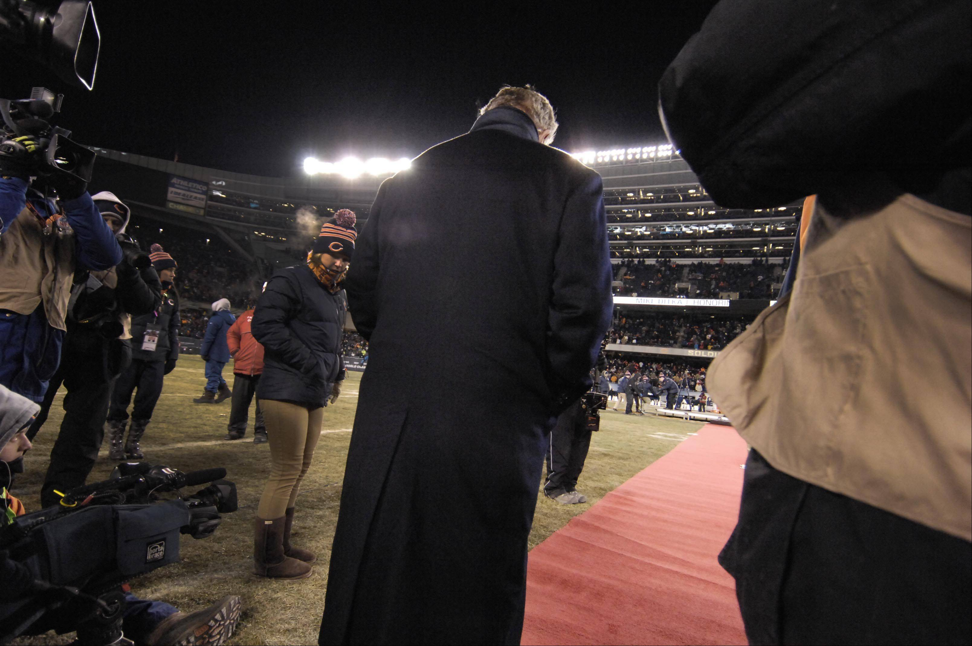 Former Chicago Bears head coach Mike Ditka waits as he is introduced for his jersey retirement ceremony.