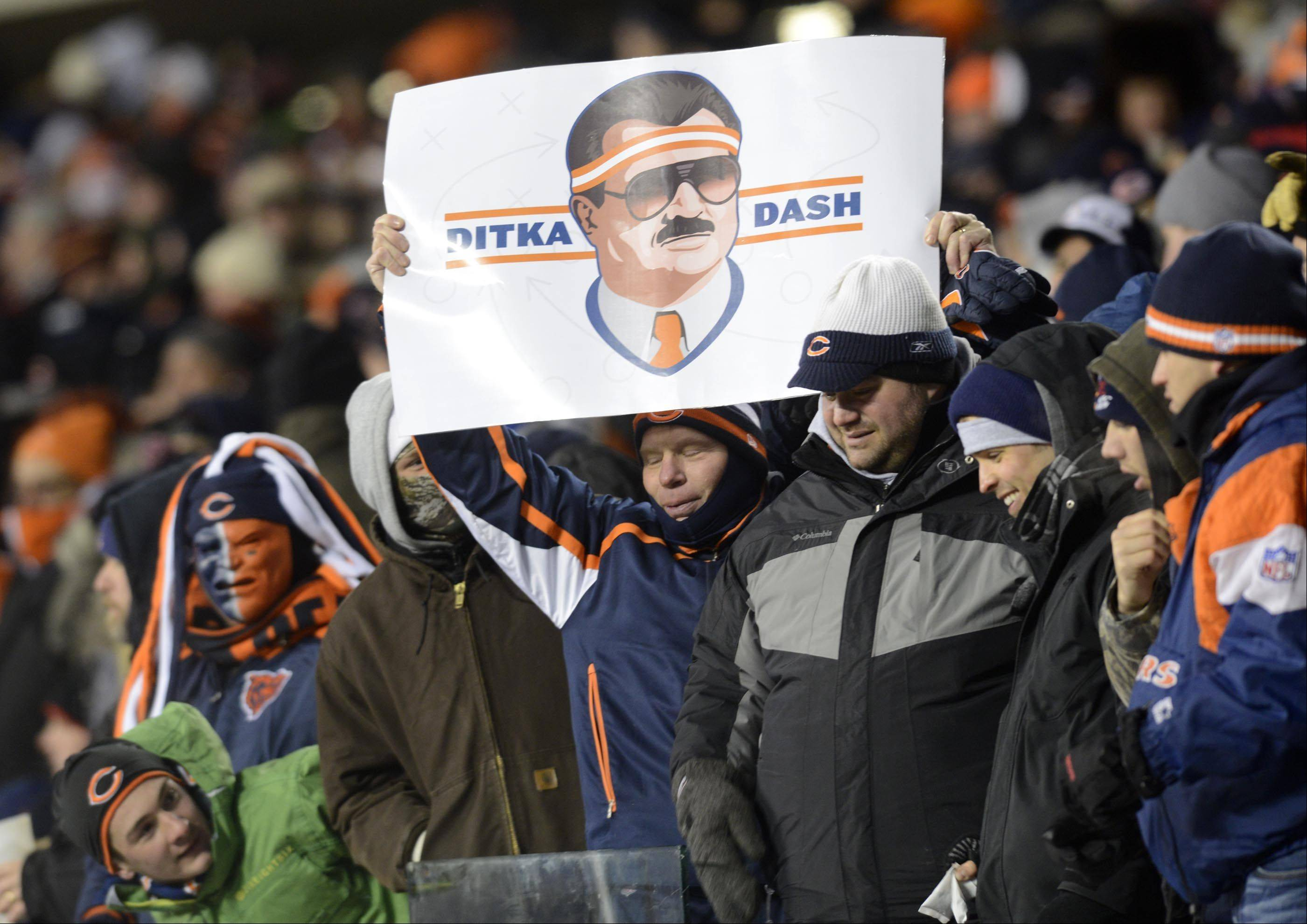 Fans celebrate former Chicago Bears coach Mike Ditka before his jersey retirement ceremony.